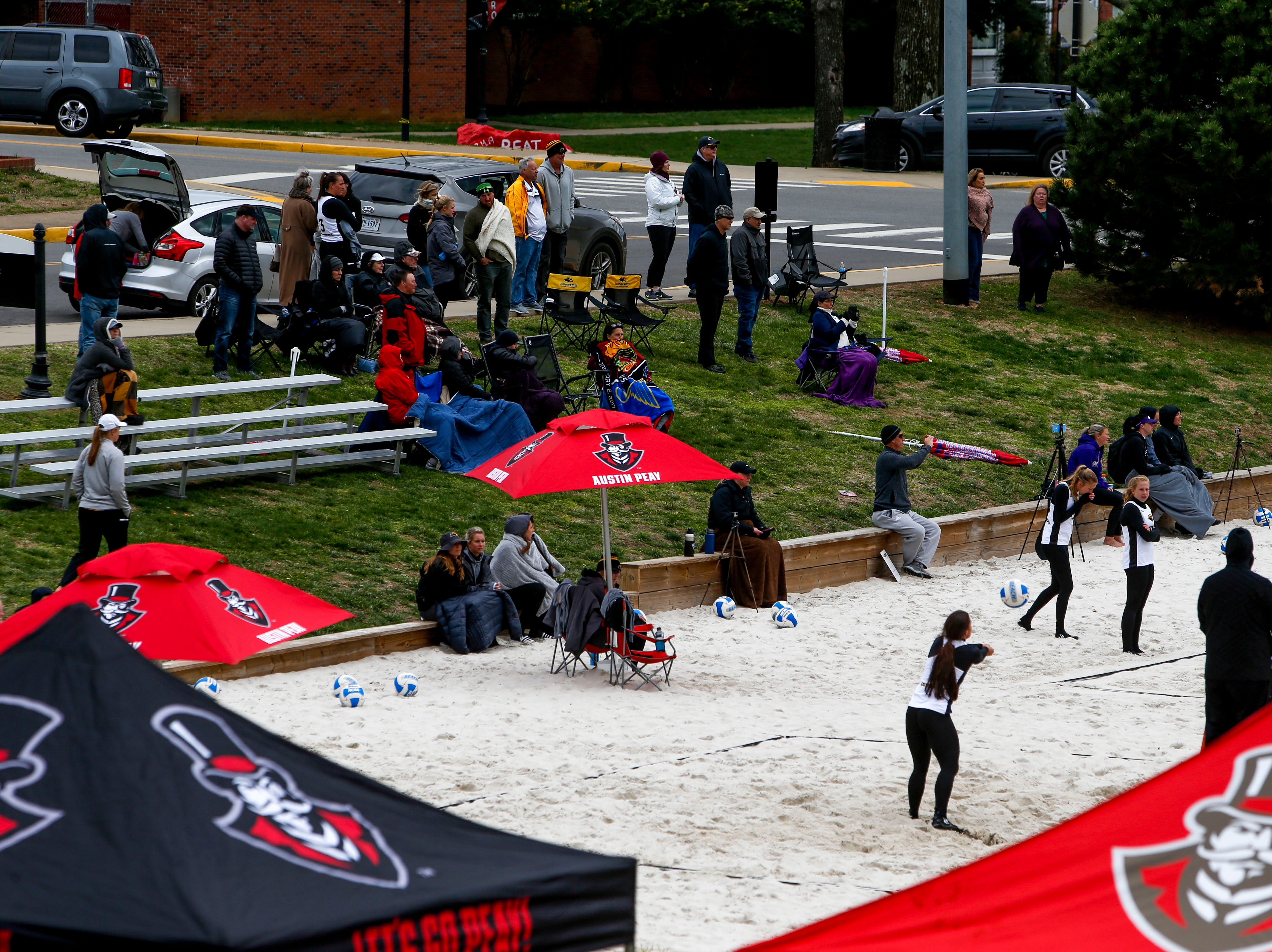 Spectators watch the game between Southern Miss and Central Arkansas at Winfield Dunn Center lawn in Clarksville, Tenn., on Friday, March 15, 2019.