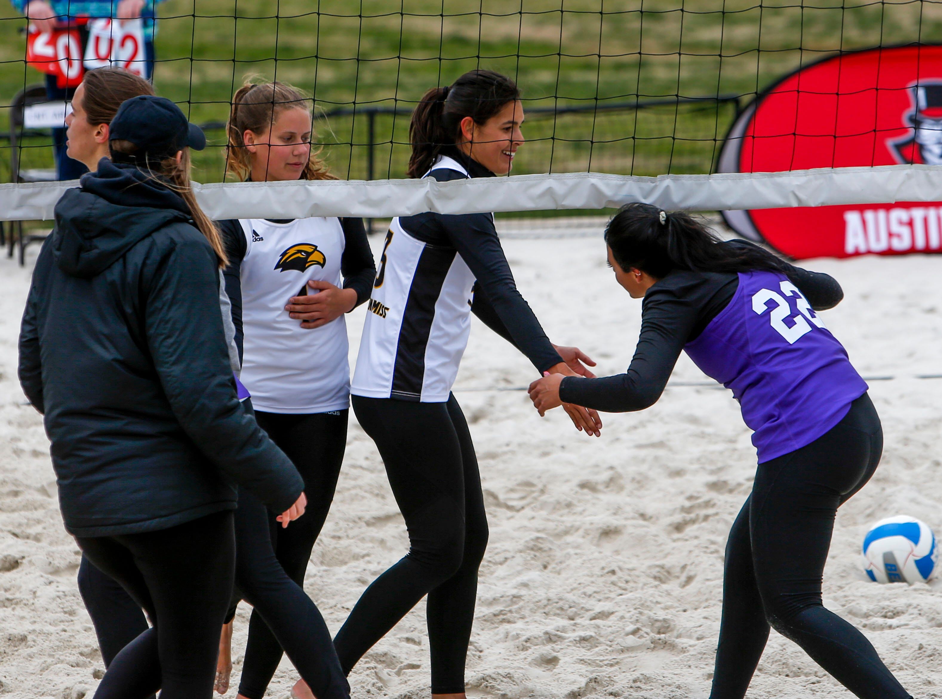 Central Arkansas and Southern Miss players shake hands and talk after a game at Winfield Dunn Center lawn in Clarksville, Tenn., on Friday, March 15, 2019.