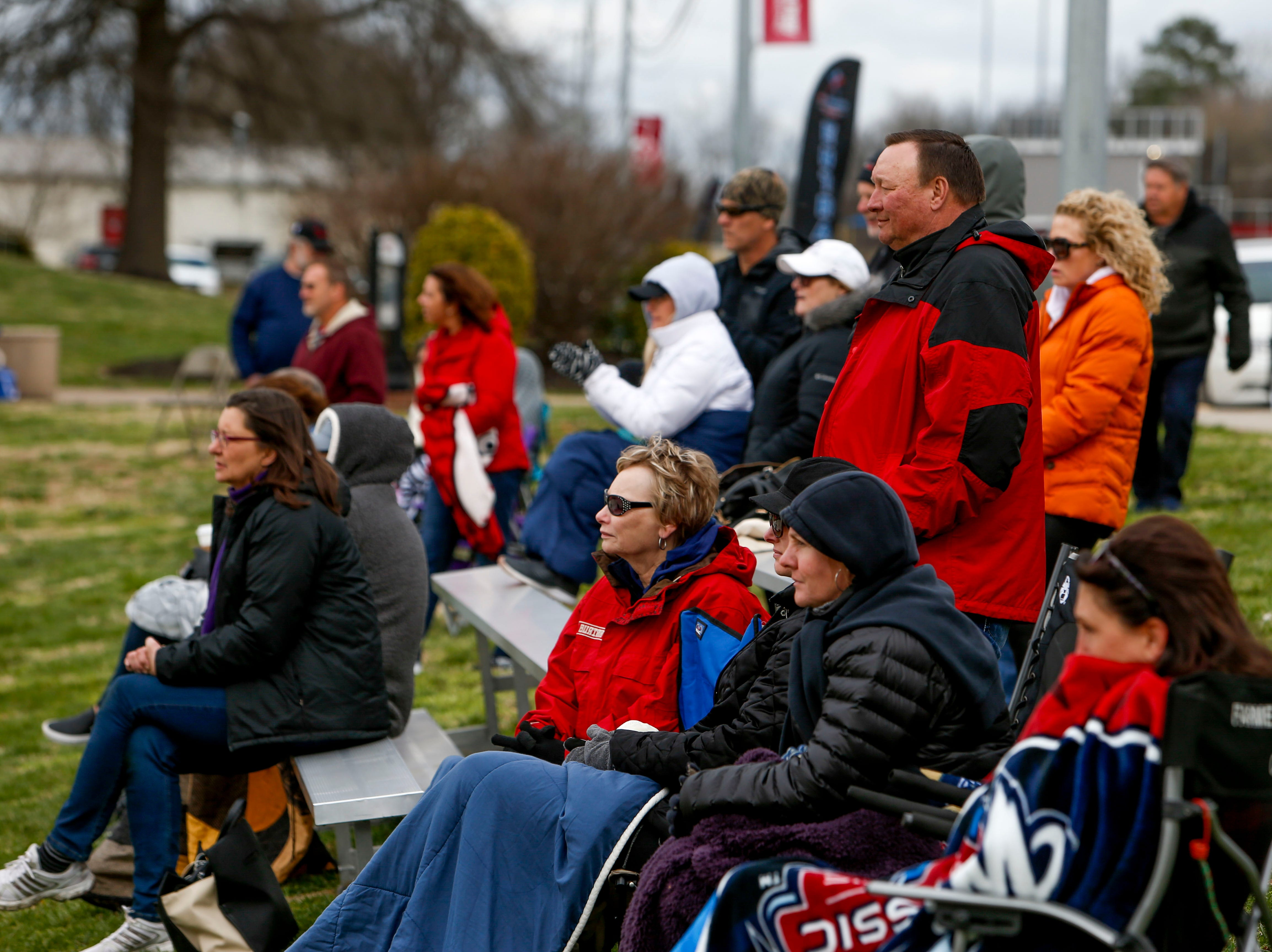 Spectators watch beach volleyball in winter jackets and covered in blankets at Winfield Dunn Center lawn in Clarksville, Tenn., on Friday, March 15, 2019.