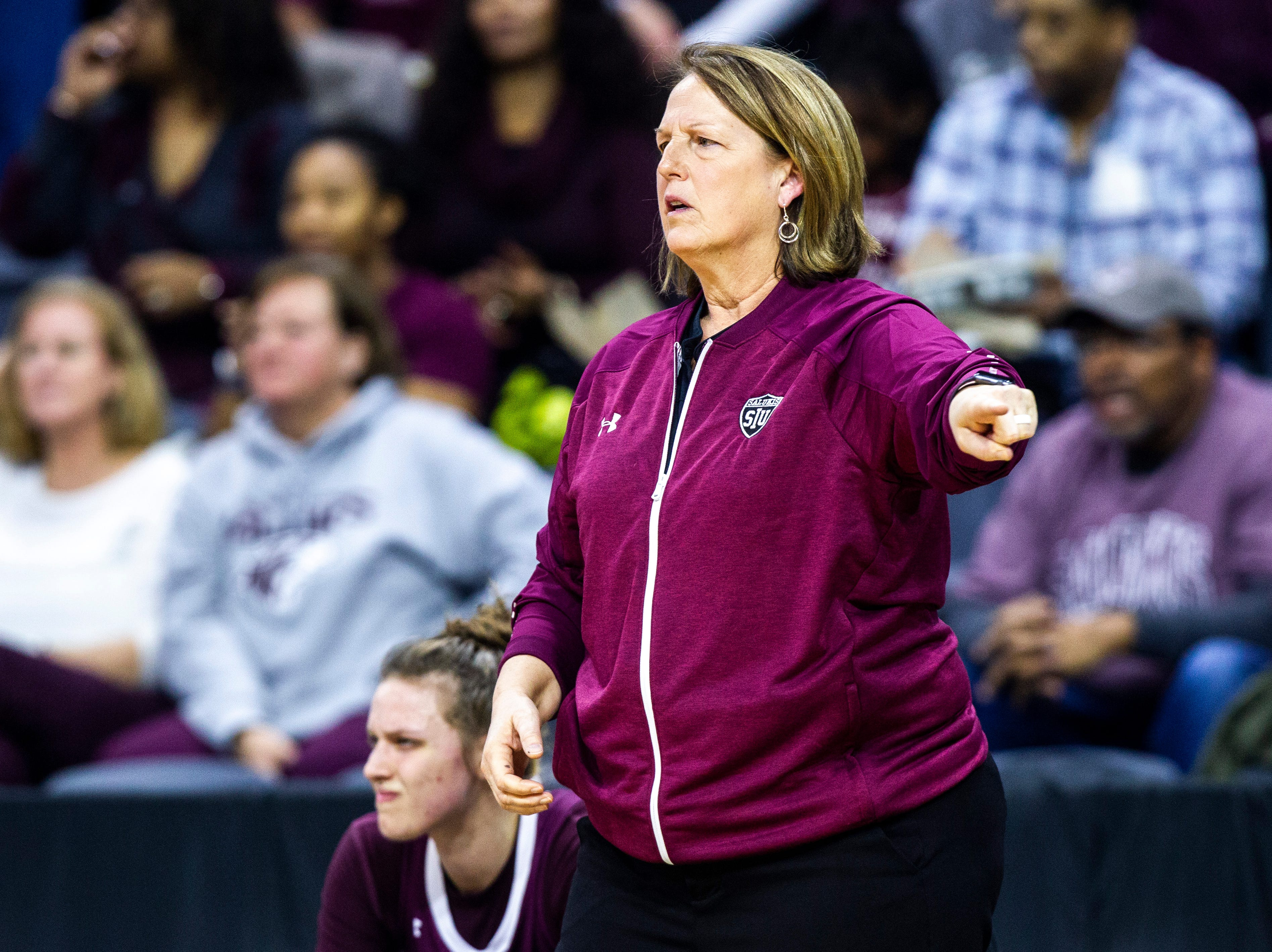 Southern Illinois head coach Cindy Stein calls out to players during a NCAA Missouri Valley Conference women's basketball quarterfinal tournament game, Friday, March 15, 2019, at the TaxSlayer Center in Moline, Illinois.