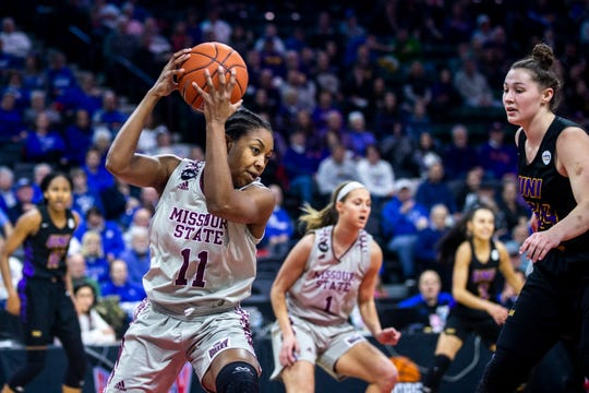 Missouri State guard Brice Calip (11) grabs a rebound against Northern Iowa forward Taylor Hagen (34) during a NCAA Missouri Valley Conference women's basketball semi final tournament game on Saturday, March 16, 2019, the TaxSlayer Center in Moline, Illinois.