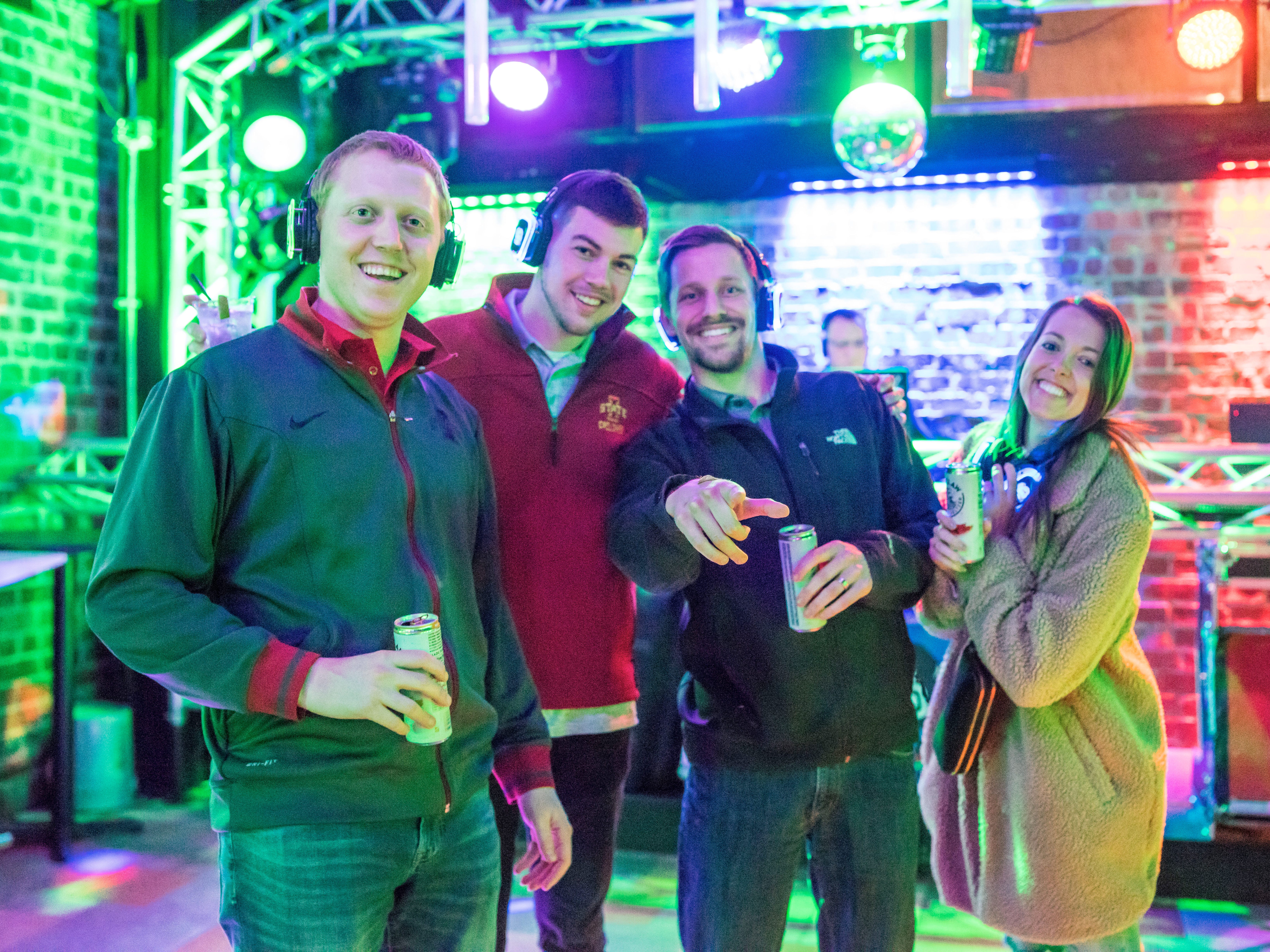 Chelsey Christensen, 25, Bryce Block, 23, Bobby Degnman, 24, and Nick Onken, 25, all of Des Moines, enjoying their night, Friday, March 15th, at Hush.
