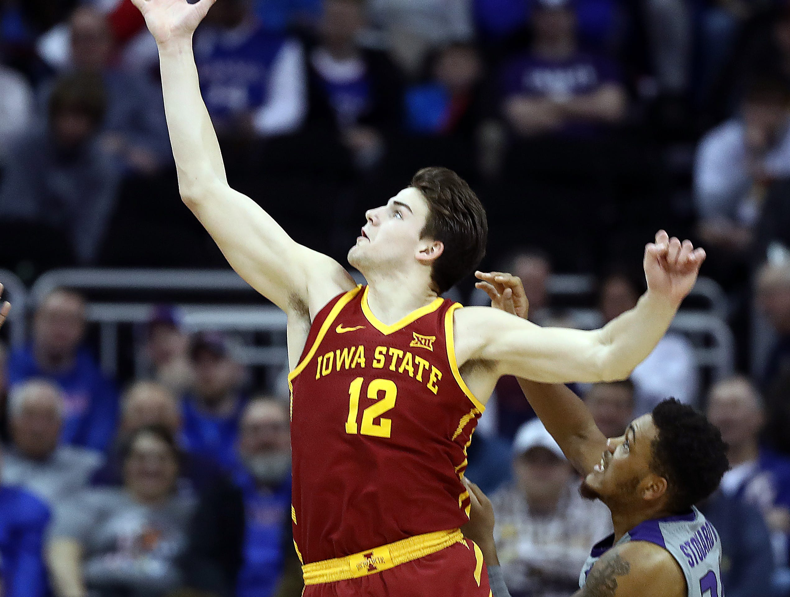 KANSAS CITY, MISSOURI - MARCH 15:  Michael Jacobson #12 of the Iowa State Cyclones reaches for a rebound as Levi Stockard III #34 of the Kansas State Wildcats defends during the semifinal game of the Big 12 Basketball Tournament at Sprint Center on March 15, 2019 in Kansas City, Missouri. (Photo by Jamie Squire/Getty Images)