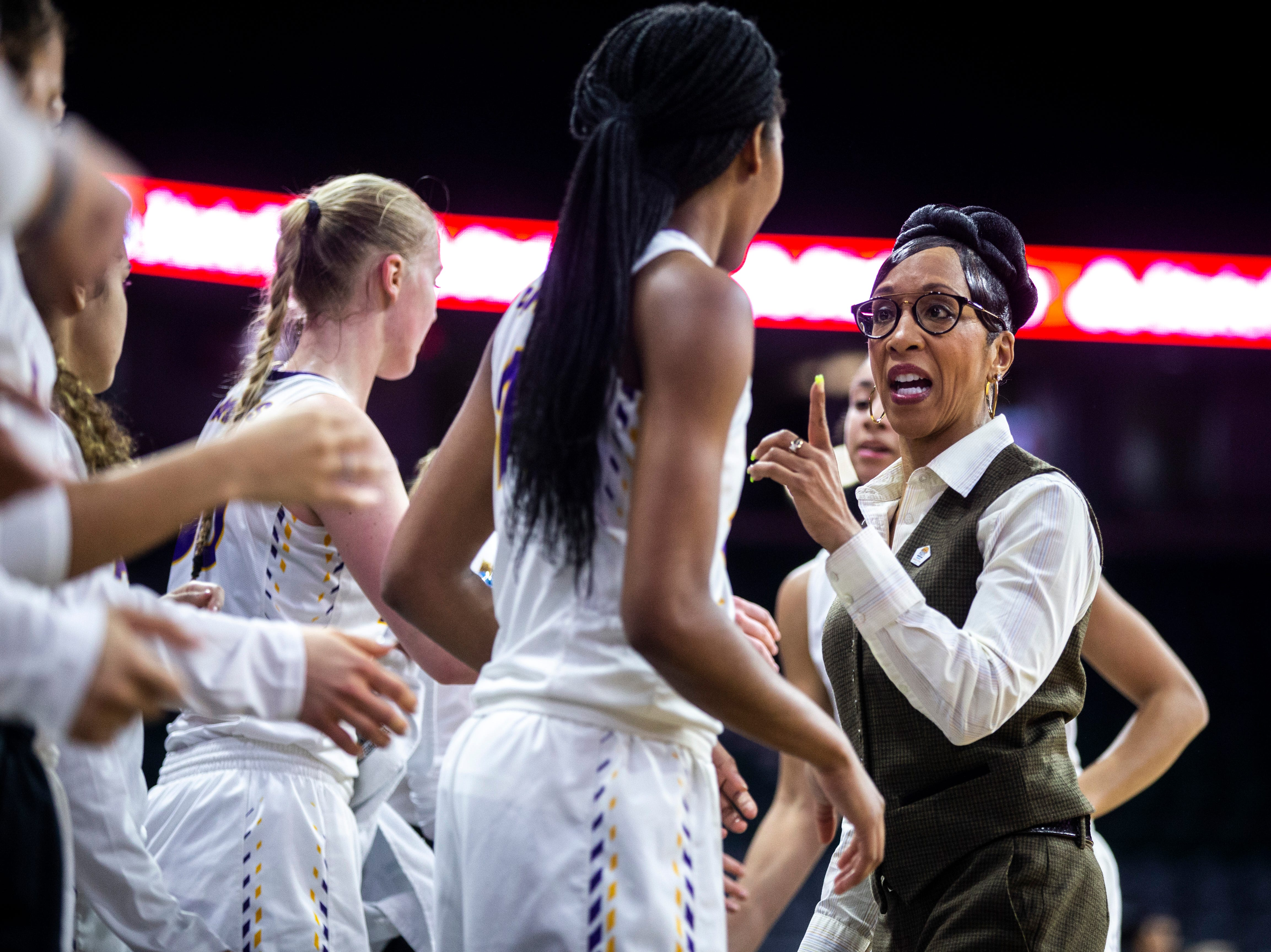 Northern Iowa head coach Tanya Warren talks with Northern Iowa forward Bre Gunnels, center, during a NCAA Missouri Valley Conference women's basketball quarterfinal tournament game, Friday, March 15, 2019, at the TaxSlayer Center in Moline, Illinois.
