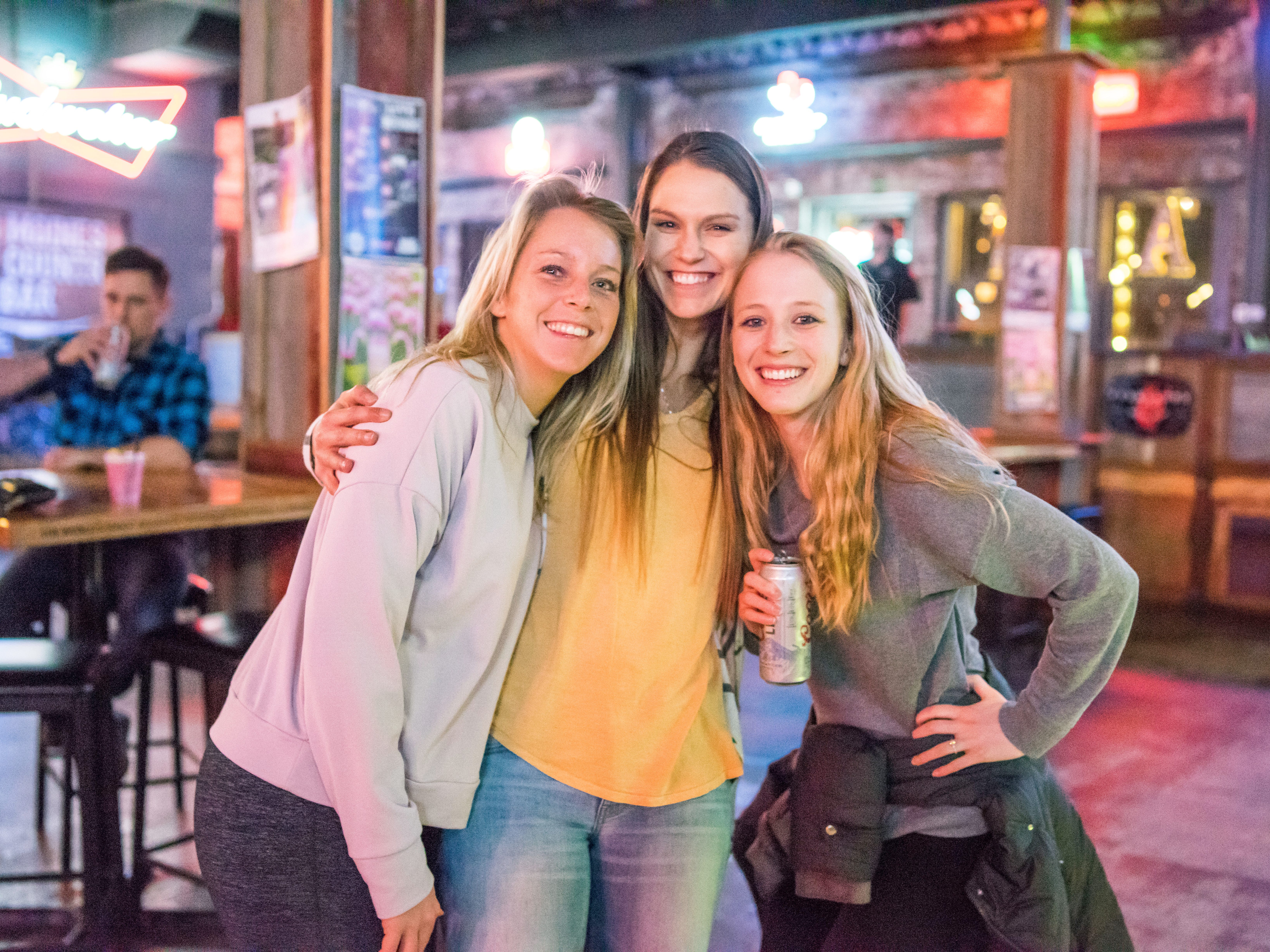 Ashley Olson, 25, Jenny Smith, 25, and Anne Reynolds, 25, all of Des Moines, having a fun time, Friday, March 15th, at Beer Can Alley.