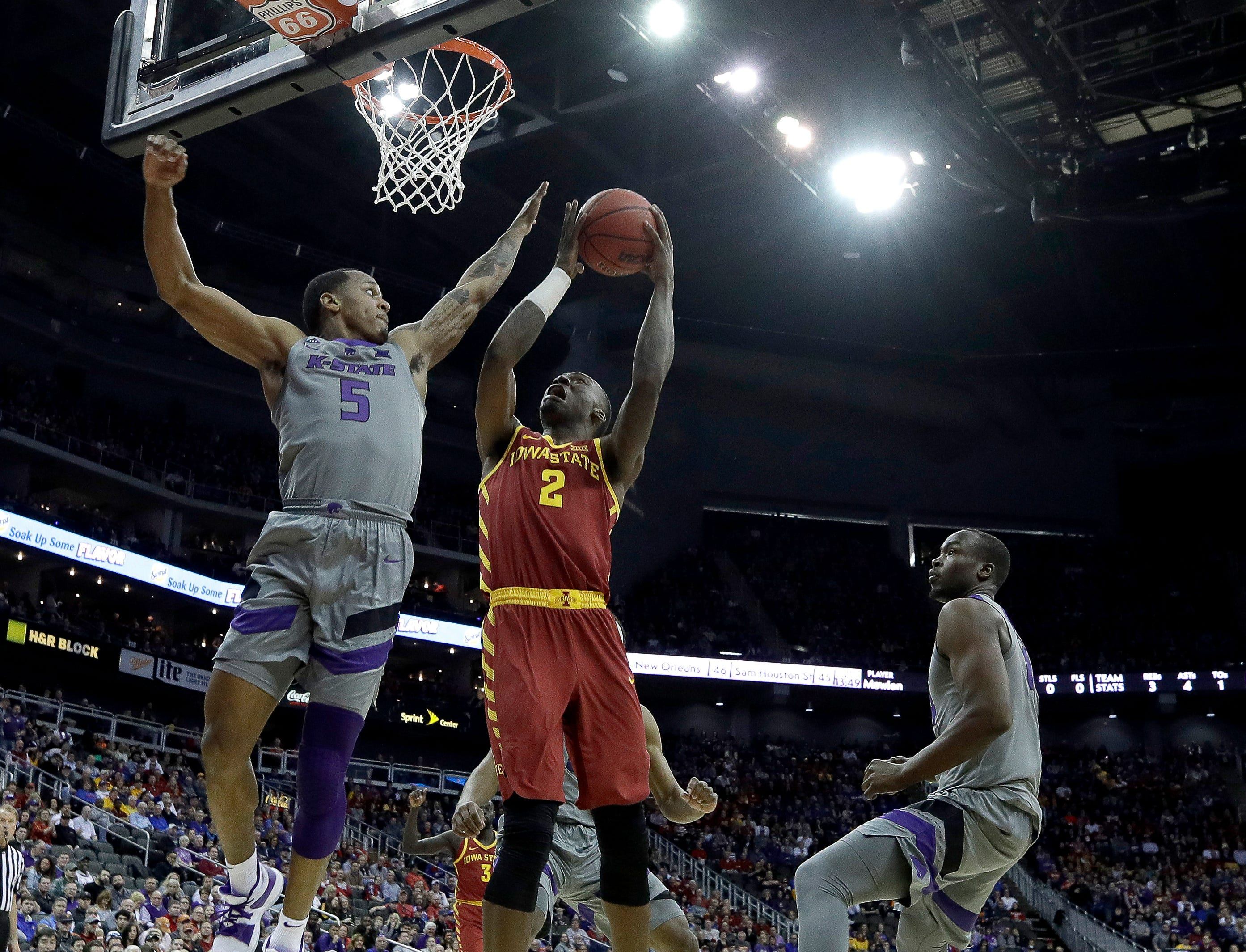 Iowa State's Cameron Lard (2) shoots while under pressure from Kansas State's Barry Brown Jr. (5) during the first half of an NCAA college basketball game in the Big 12 men's tournament Friday, March 15, 2019, in Kansas City, Mo. (AP Photo/Charlie Riedel)