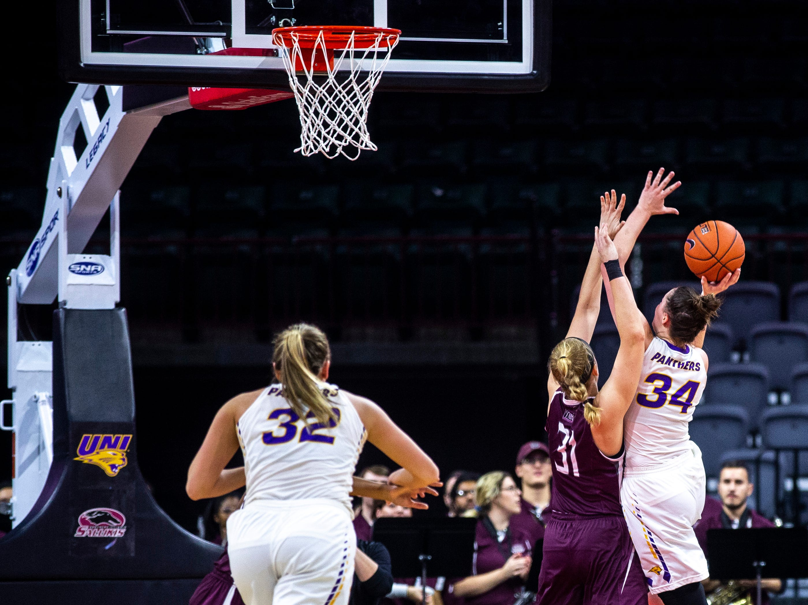 Northern Iowa forward Taylor Hagen (34) drives to the basket against Southern Illinois' Lauren Hartman (31) during a NCAA Missouri Valley Conference women's basketball quarterfinal tournament game, Friday, March 15, 2019, at the TaxSlayer Center in Moline, Illinois.