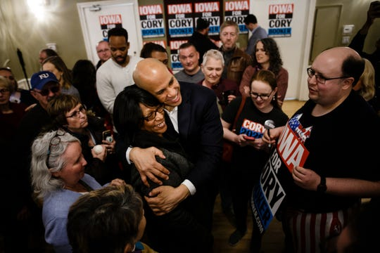 New Jersey Senator and 2020 Democratic presidential candidate Cory Booker hugs a supporter during a campaign event at Hotel Ottumwa on Saturday, March 16, 2019 in Ottumwa.