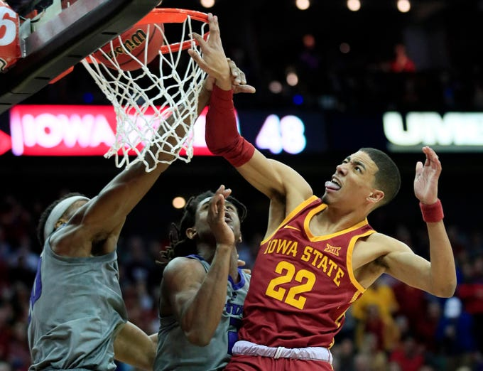 Iowa State guard Tyrese Haliburton (22) dunks over Kansas State forward Xavier Sneed, left, and guard Cartier Diarra, center, during the second half of an NCAA college basketball game in the semifinals of the Big 12 conference tournament in Kansas City, Mo., Friday, March 15, 2019. Iowa State won 63-59. (AP Photo/Orlin Wagner)