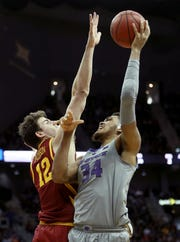 KANSAS CITY, MISSOURI - MARCH 15:  Levi Stockard III #34 of the Kansas State Wildcats shoots over Michael Jacobson #12 of the Iowa State Cyclones during the semifinal game of the Big 12 Basketball Tournament at Sprint Center on March 15, 2019 in Kansas City, Missouri. (Photo by Jamie Squire/Getty Images)
