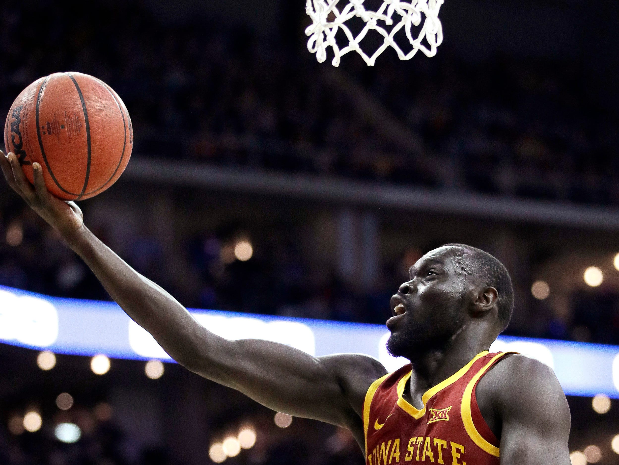 Iowa State's Marial Shayok (3) shoots over Kansas State's Xavier Sneed (20) during the first half of an NCAA college basketball game in the Big 12 men's tournament Friday, March 15, 2019, in Kansas City, Mo. (AP Photo/Charlie Riedel)