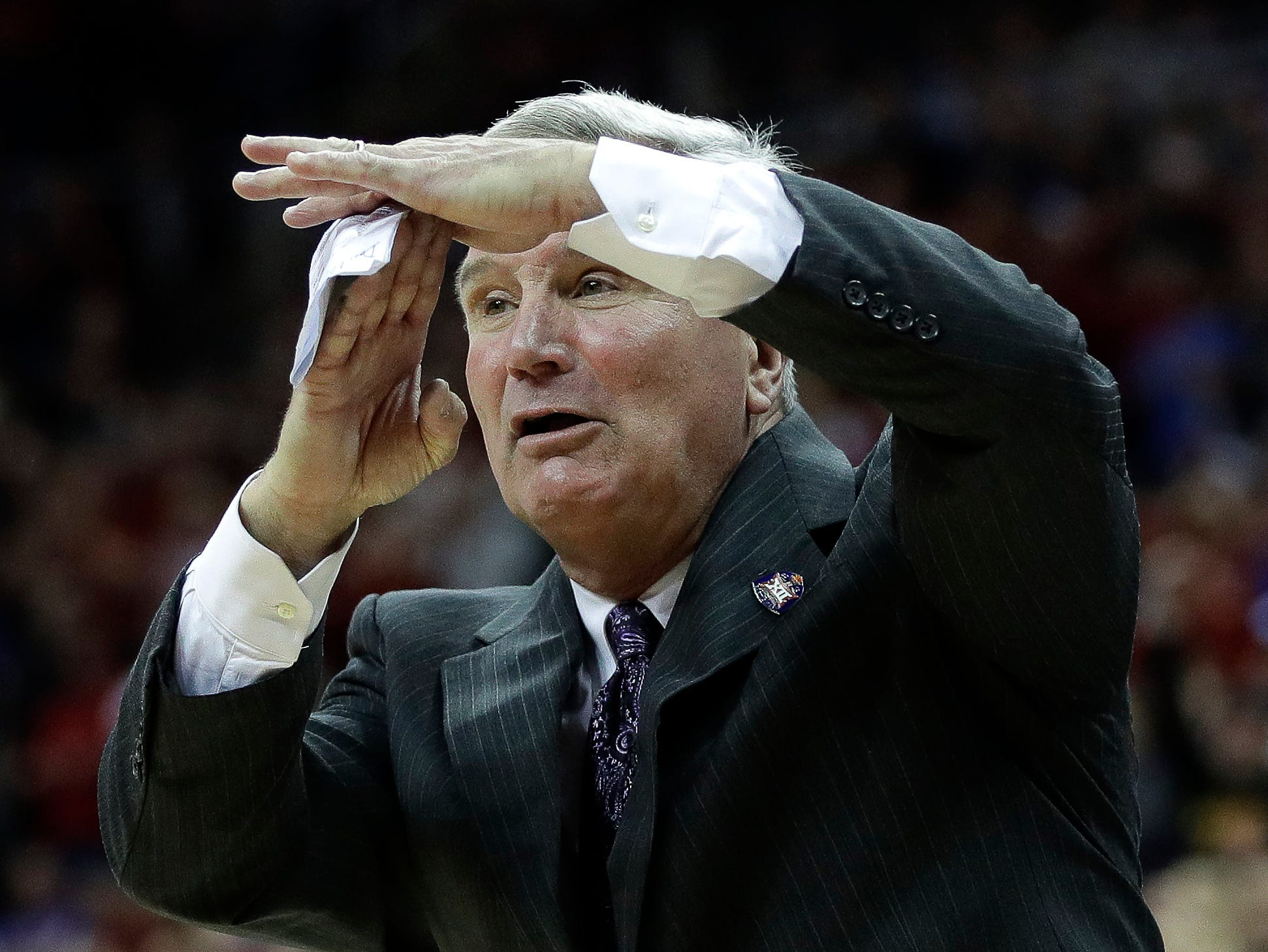 Kansas State coach Bruce Weber calls for a timeout during the first half of the team's NCAA college basketball game against Iowa State in the Big 12 men's tournament Friday, March 15, 2019, in Kansas City, Mo. (AP Photo/Charlie Riedel)