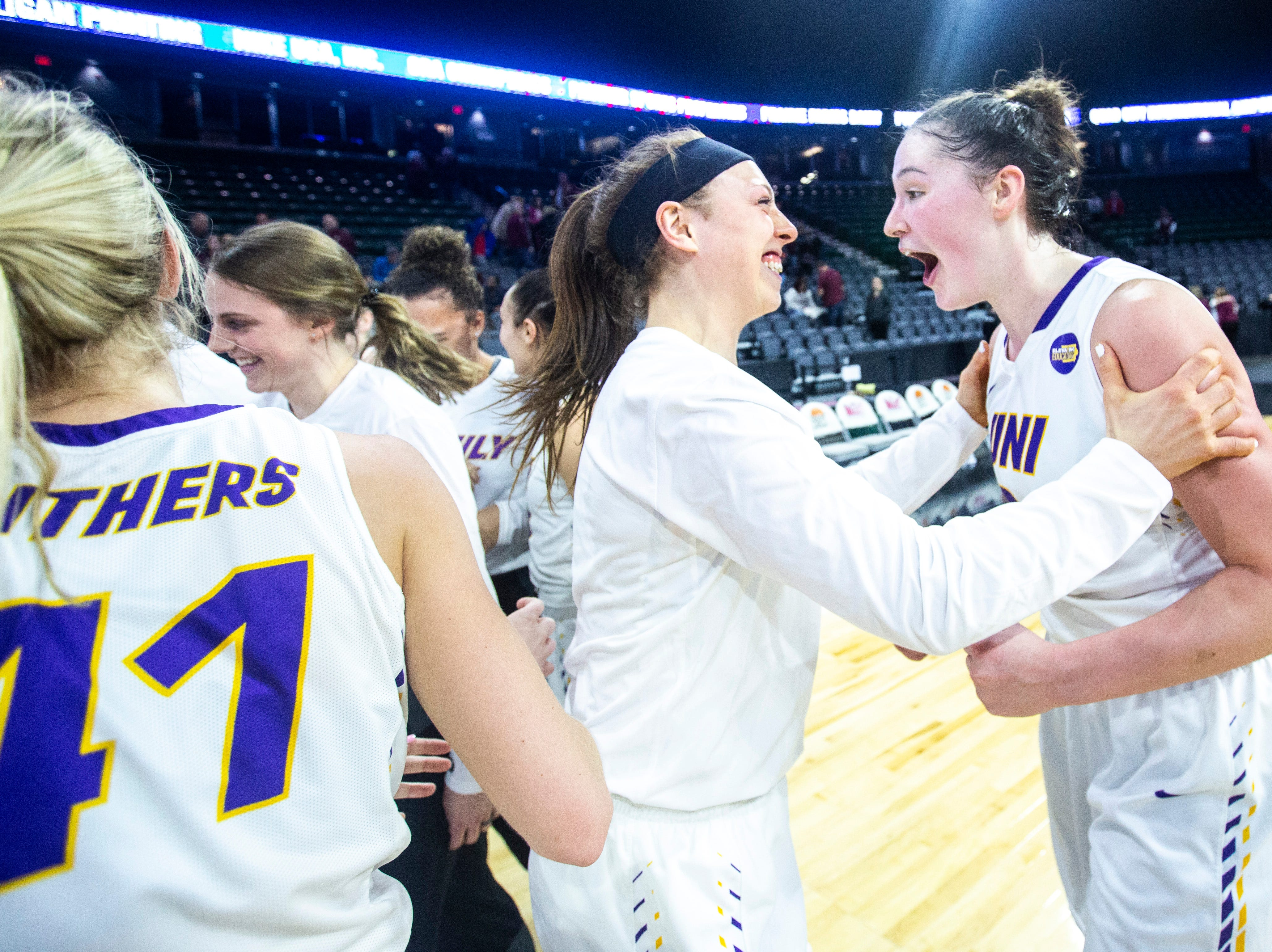 Northern Iowa Panthers celebrate after a NCAA Missouri Valley Conference women's basketball quarterfinal tournament game against Southern Illinois, Friday, March 15, 2019, at the TaxSlayer Center in Moline, Illinois. Northern Iowa won, 66-63.