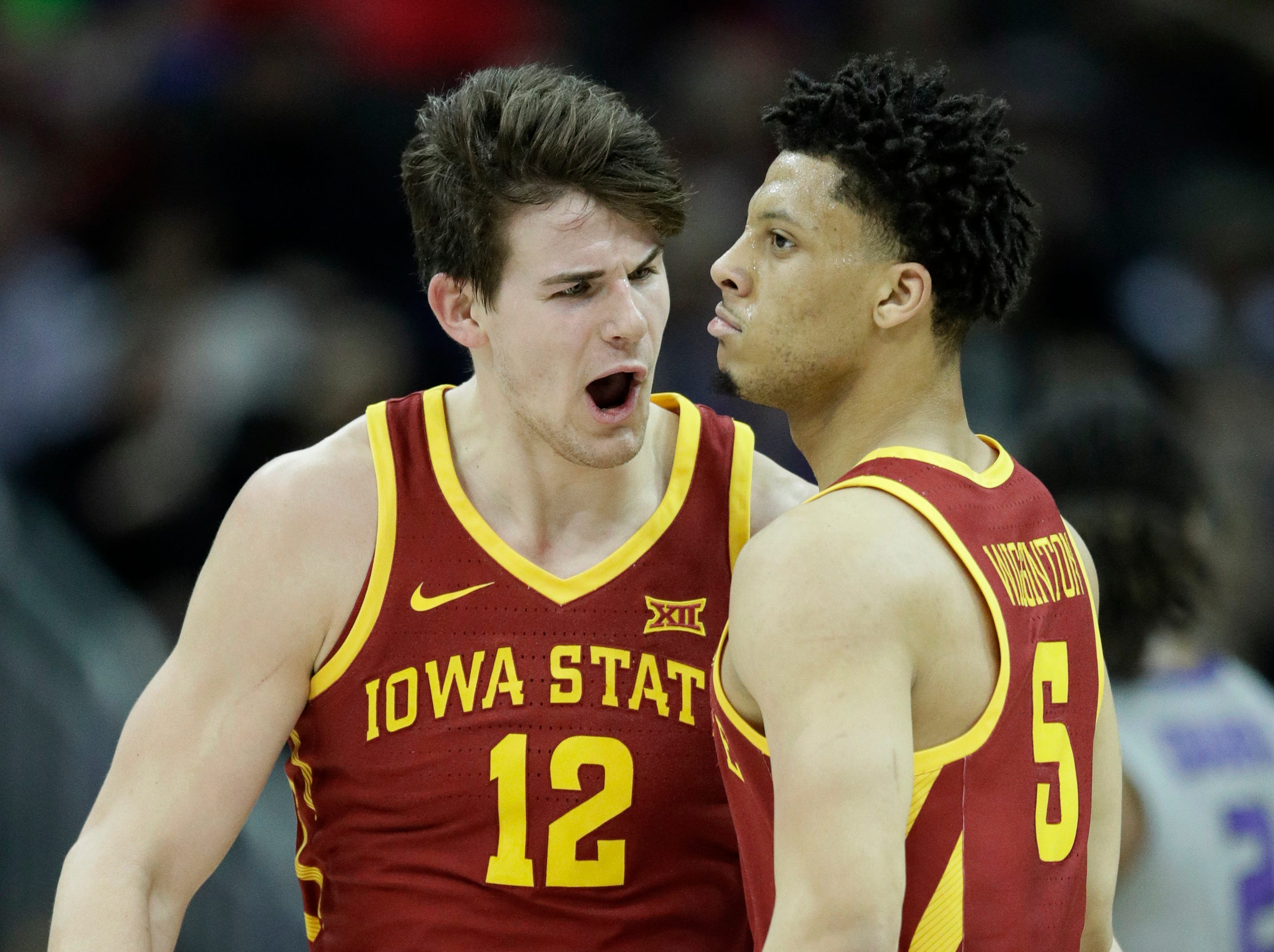 Iowa State forward Michael Jacobson (12) congratulates guard Lindell Wigginton (5) after a made basket during the first half of the team's NCAA college basketball game against Kansas State in the semifinals of the Big 12 conference tournament in Kansas City, Mo., Friday, March 15, 2019. (AP Photo/Orlin Wagner)