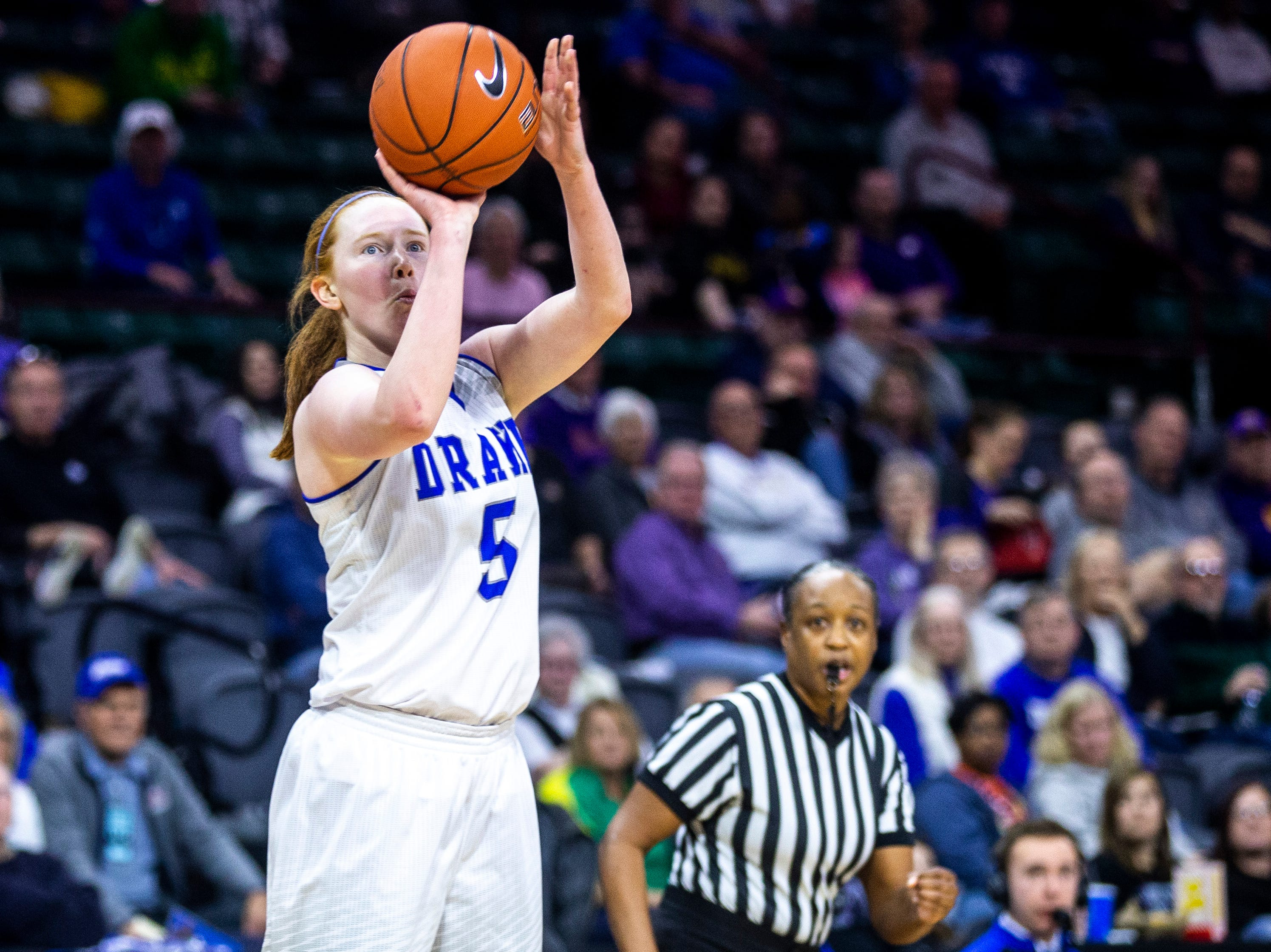 Drake guard Becca Hittner (5) makes a 3-point basket during a NCAA Missouri Valley Conference women's basketball semi final tournament game on Saturday, March 16, 2019, the TaxSlayer Center in Moline, Illinois.