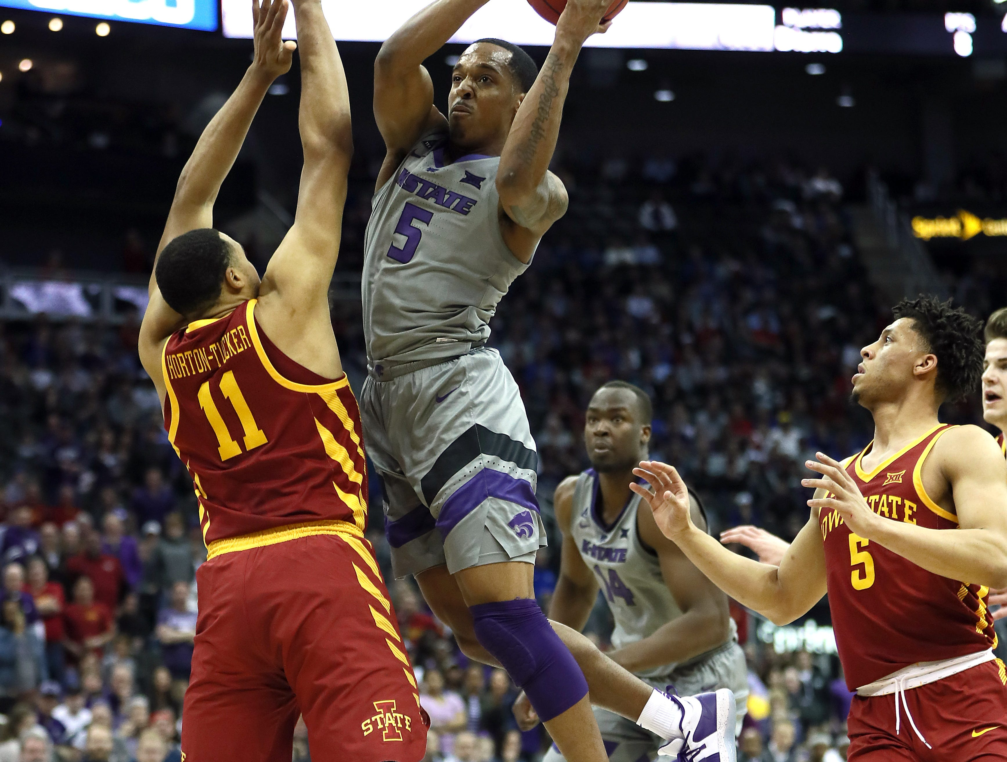 KANSAS CITY, MISSOURI - MARCH 15:  Barry Brown Jr. #5 of the Kansas State Wildcats drives toward the basket as Talen Horton-Tucker #11 of the Iowa State Cyclones defends during the semifinal game of the Big 12 Basketball Tournament at Sprint Center on March 15, 2019 in Kansas City, Missouri. (Photo by Jamie Squire/Getty Images)