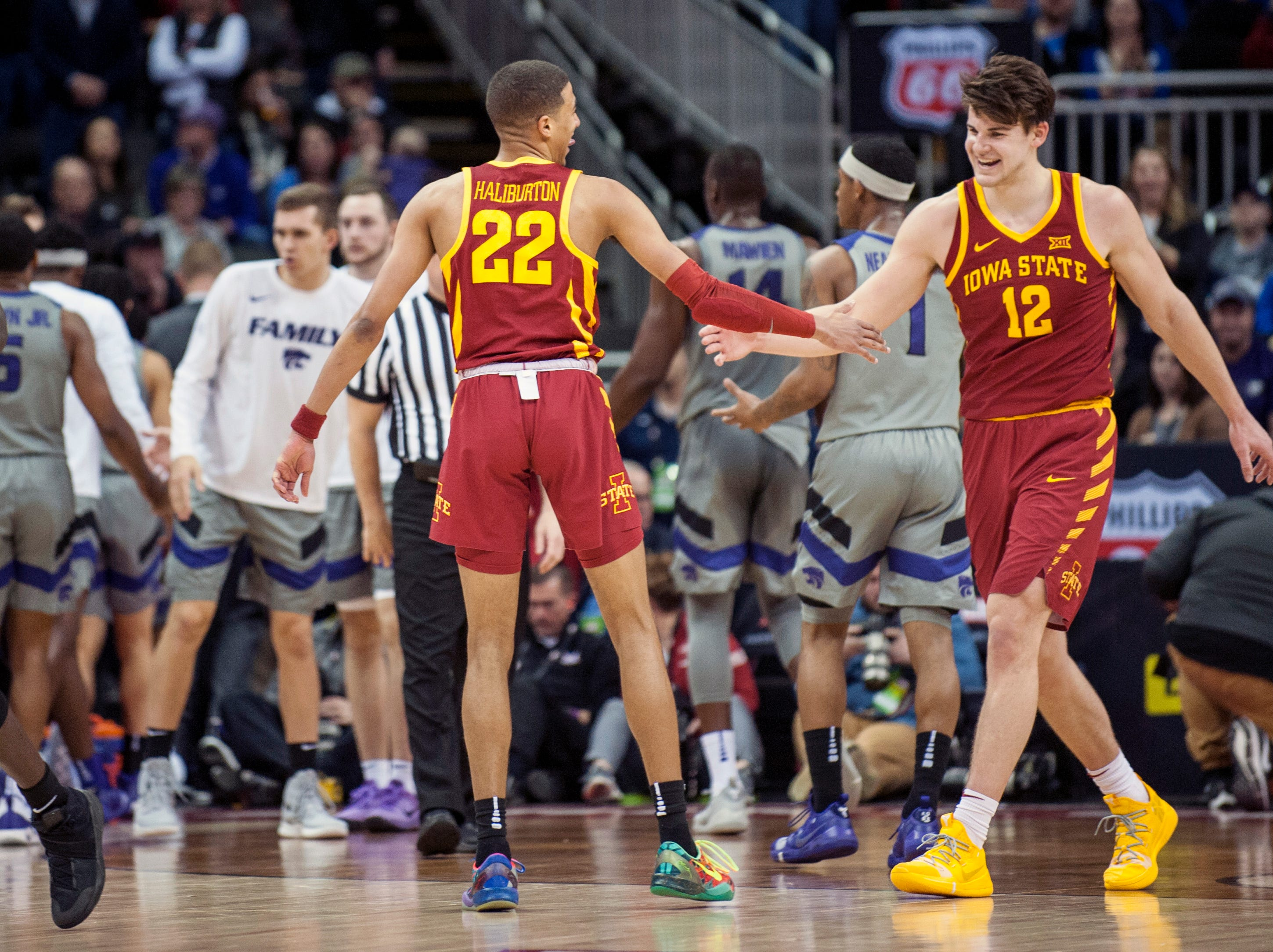 Mar 15, 2019; Kansas City, MO, USA; Iowa State Cyclones guard Tyrese Haliburton (22) and Iowa State Cyclones forward Michael Jacobson (12) high-five during the first half against the Kansas State Wildcats in the semifinals of the Big 12 conference tournament at Sprint Center. Mandatory Credit: Amy Kontras-USA TODAY Sports