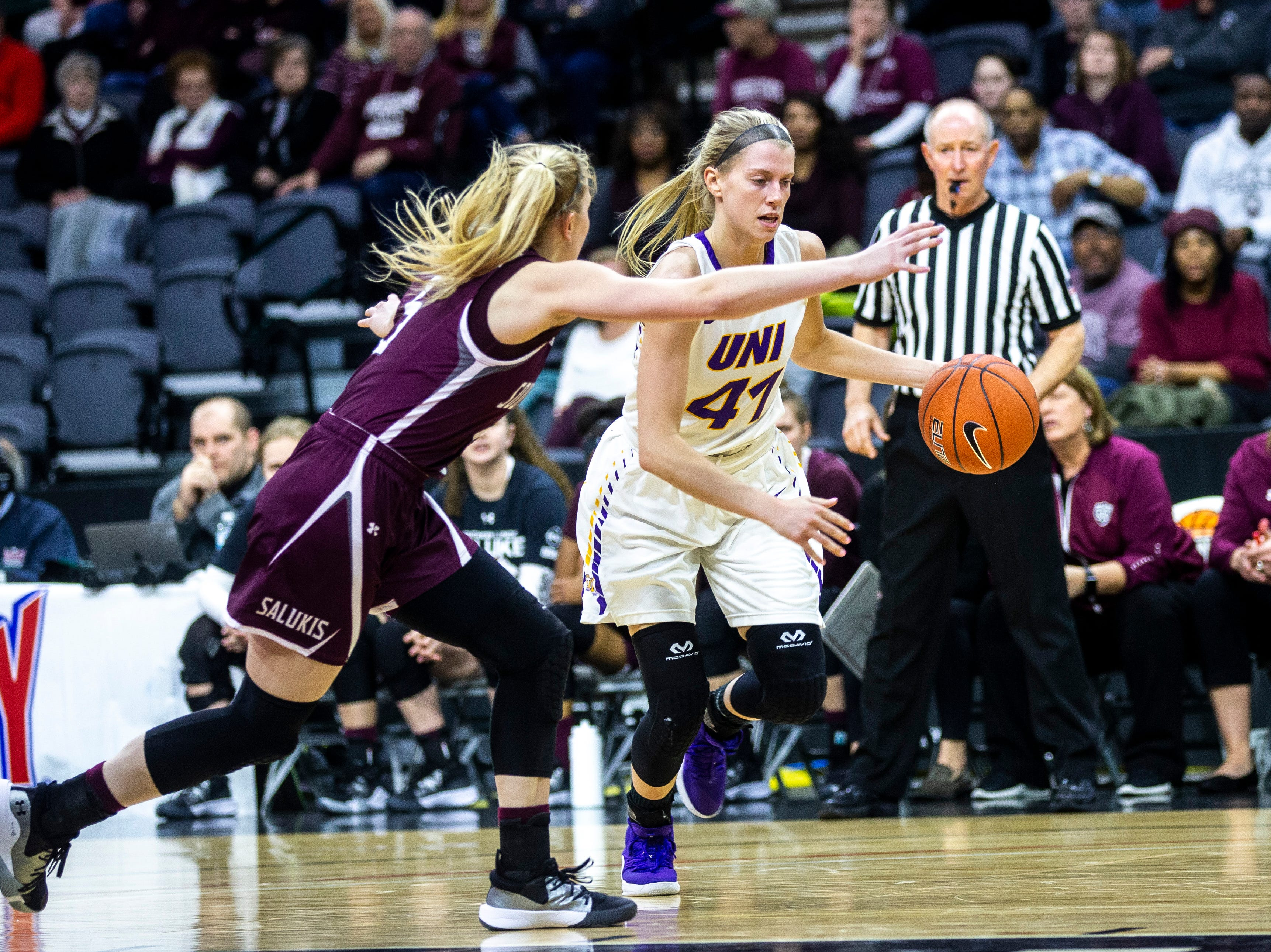 Northern Iowa guard Abby Gerrits (41) takes the ball up court during a NCAA Missouri Valley Conference women's basketball quarterfinal tournament game, Friday, March 15, 2019, at the TaxSlayer Center in Moline, Illinois.