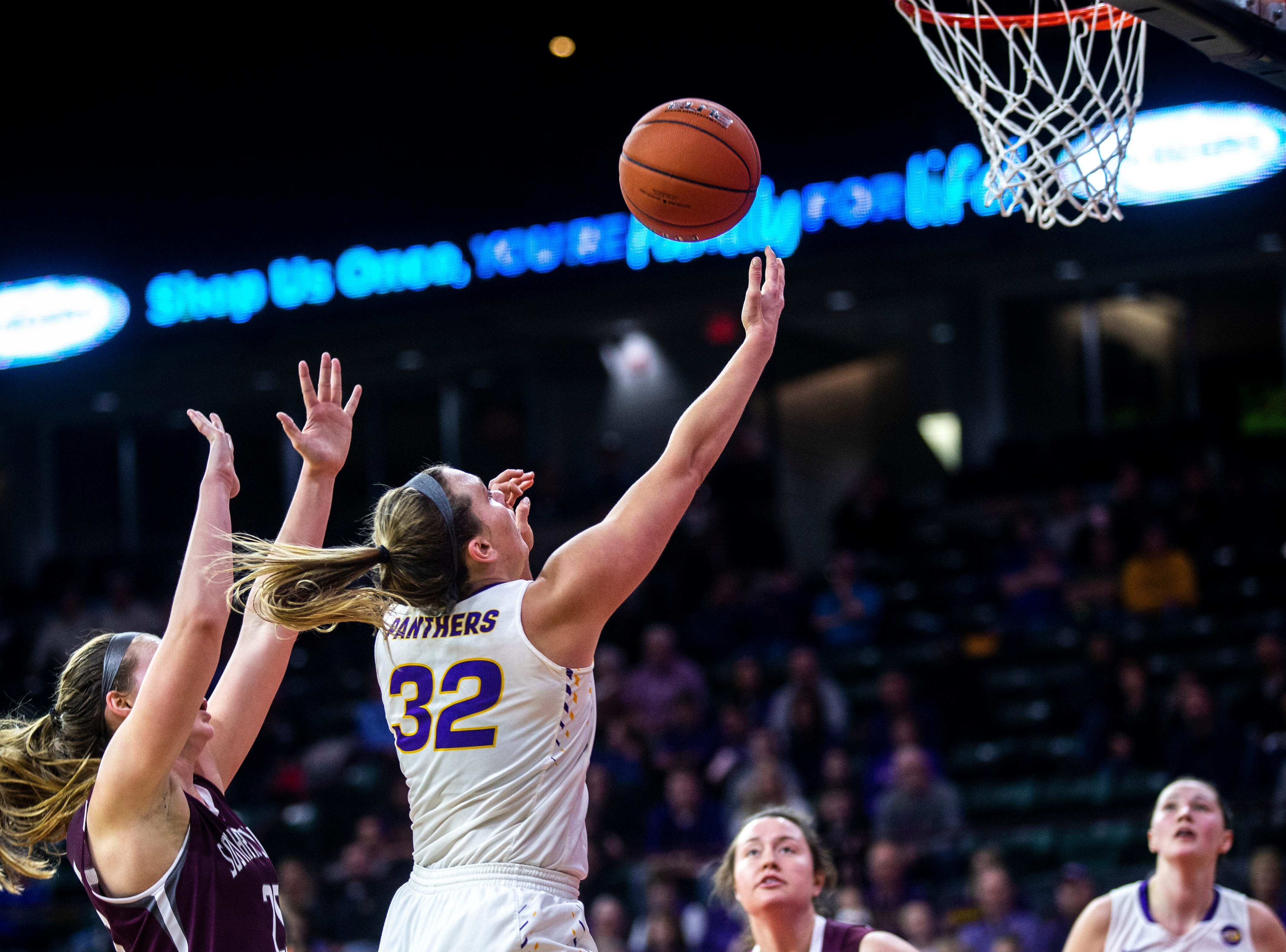 Northern Iowa forward Heidi Hillyard (32) drives to the basket during a NCAA Missouri Valley Conference women's basketball quarterfinal tournament game, Friday, March 15, 2019, at the TaxSlayer Center in Moline, Illinois.