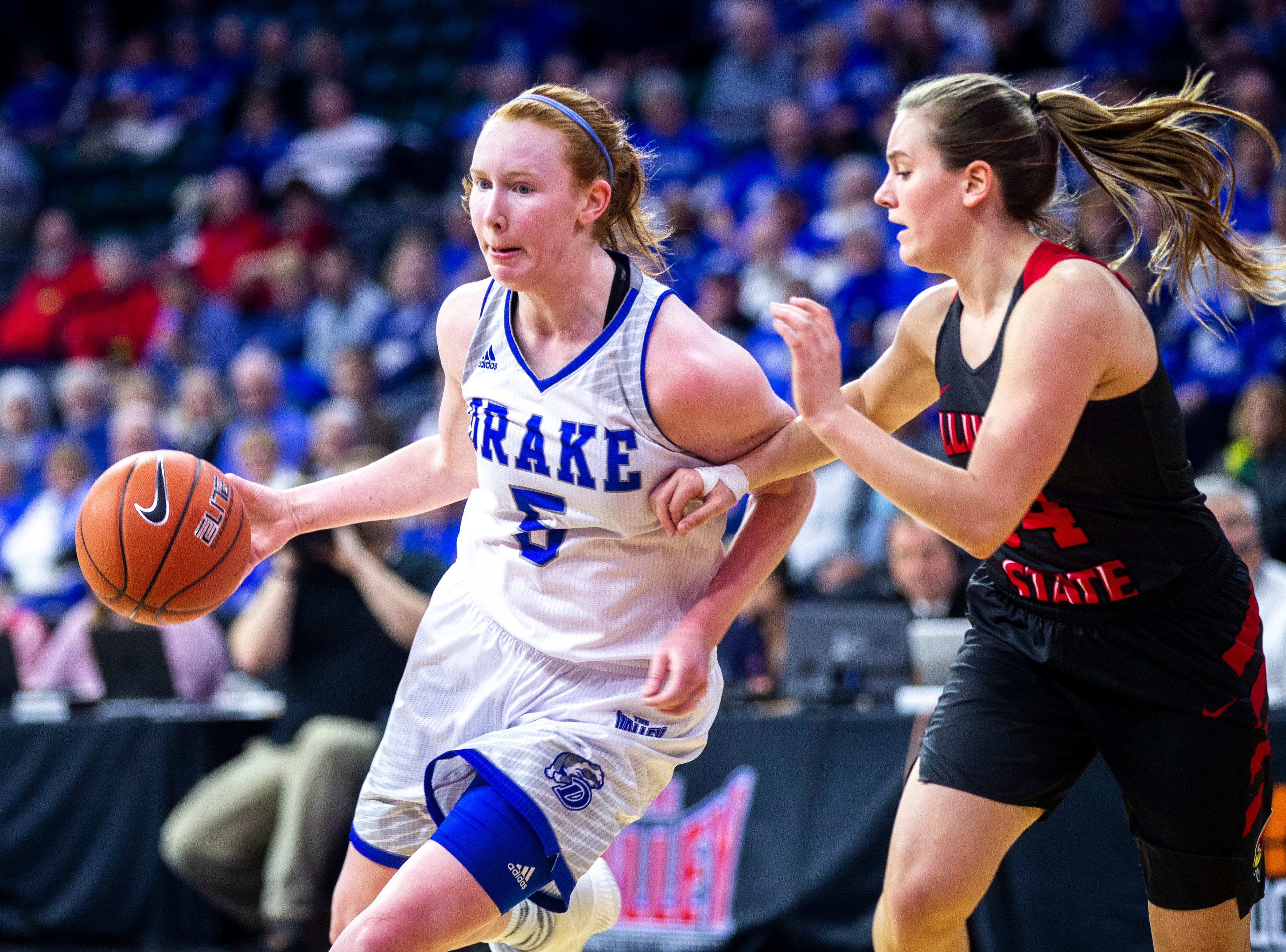 Drake guard Becca Hittner (5) drives to the basket against Illinois State guard Paige Saylor (14) during a NCAA Missouri Valley Conference women's basketball semi final tournament game on Saturday, March 16, 2019, the TaxSlayer Center in Moline, Illinois.