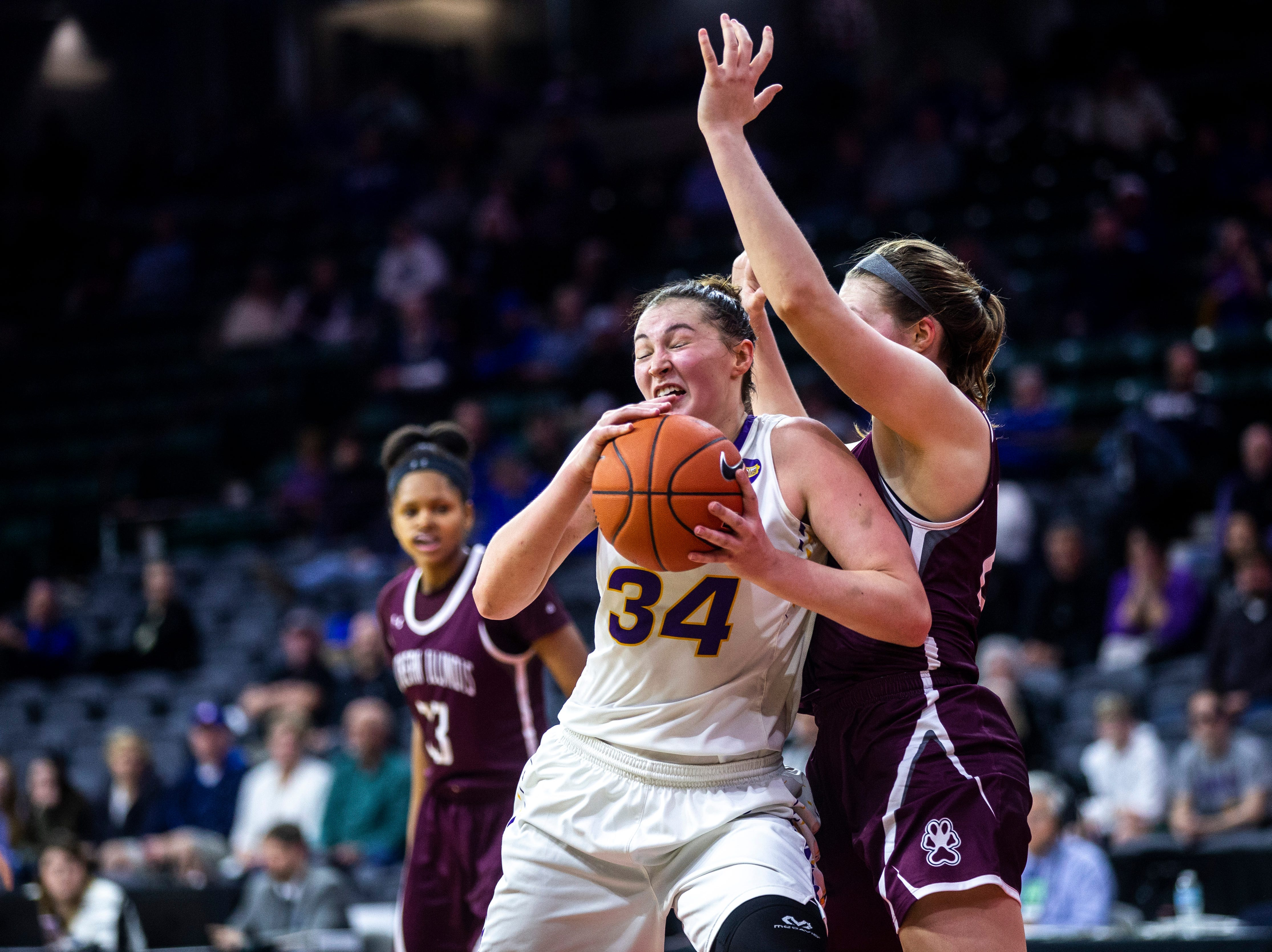Northern Iowa forward Taylor Hagen (34) drives to the basket during a NCAA Missouri Valley Conference women's basketball quarterfinal tournament game, Friday, March 15, 2019, at the TaxSlayer Center in Moline, Illinois.