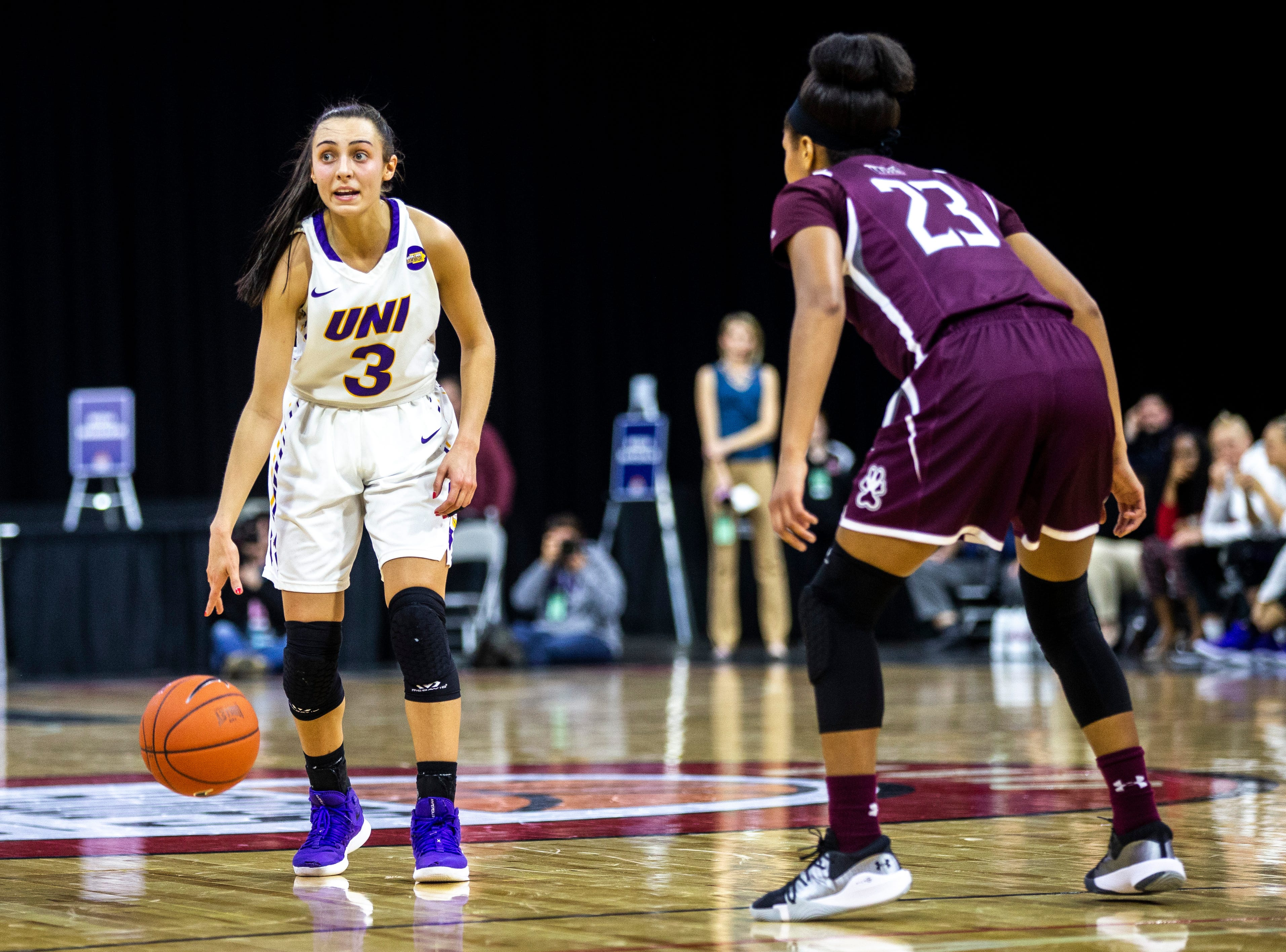 Northern Iowa guard Karli Rucker (3) dribbles while Southern Illinois guard Kristen Nelson (23) defends during a NCAA Missouri Valley Conference women's basketball quarterfinal tournament game, Friday, March 15, 2019, at the TaxSlayer Center in Moline, Illinois.