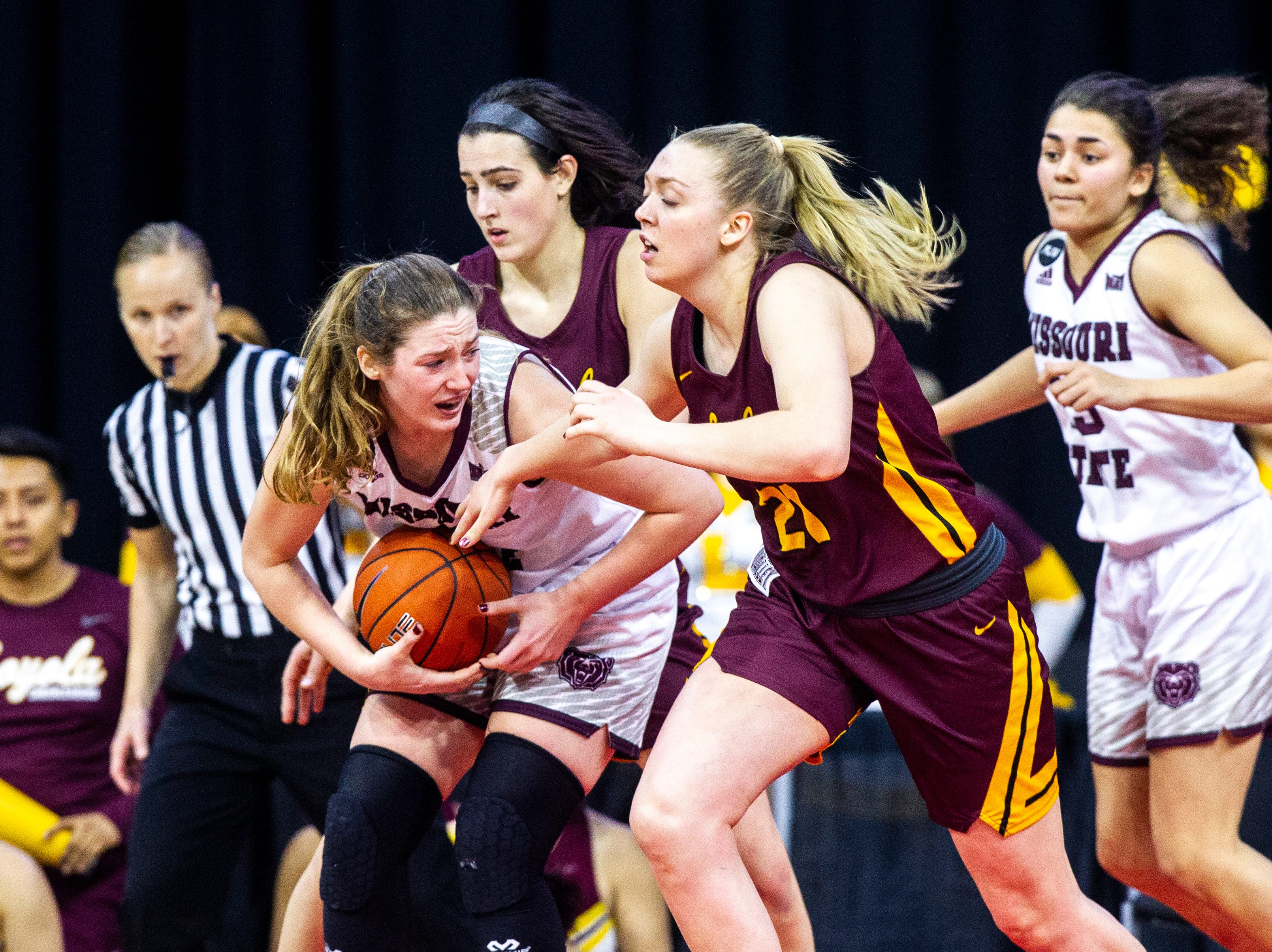 Missouri State forward Abby Hipp grabs a rebound against Loyola (Chicago)'s Abby O'Connor, second from left, and Loyola (Chicago) forward Allison Day (21) during a NCAA Missouri Valley Conference women's basketball quarterfinal tournament game, Friday, March 15, 2019, at the TaxSlayer Center in Moline, Illinois.