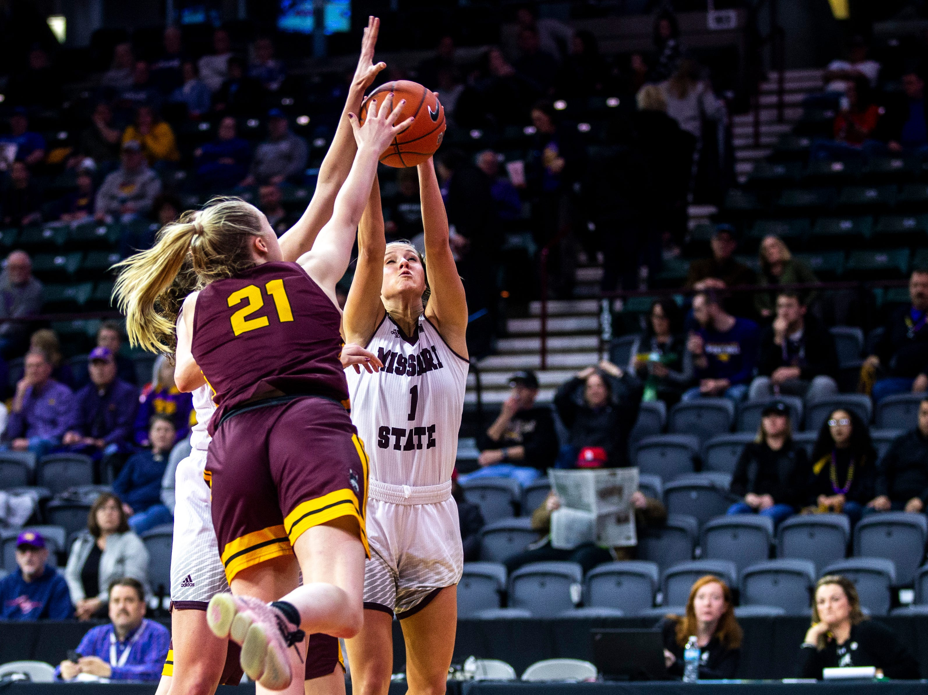 Missouri State guard Danielle Gitzen (1) grabs a rebound against Loyola (Chicago) forward Allison Day (21) during a NCAA Missouri Valley Conference women's basketball quarterfinal tournament game, Friday, March 15, 2019, at the TaxSlayer Center in Moline, Illinois.