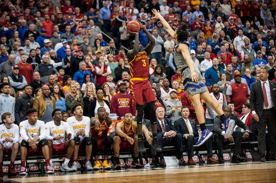 Mar 15, 2019; Kansas City, MO, USA; Iowa State Cyclones guard Marial Shayok (3) shoots a three-point shot while defended by Kansas State Wildcats guard Mike McGuirl (00) during the second half of the semifinals of the Big 12 conference tournament at Sprint Center. Mandatory Credit: Amy Kontras-USA TODAY Sports