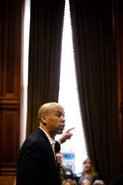 New Jersey Senator and 2020 Democratic presidential candidate Cory Booker speaks in the Supreme Court room at the Iowa State Capitol on Saturday, March 16, 2019 in Des Moines.