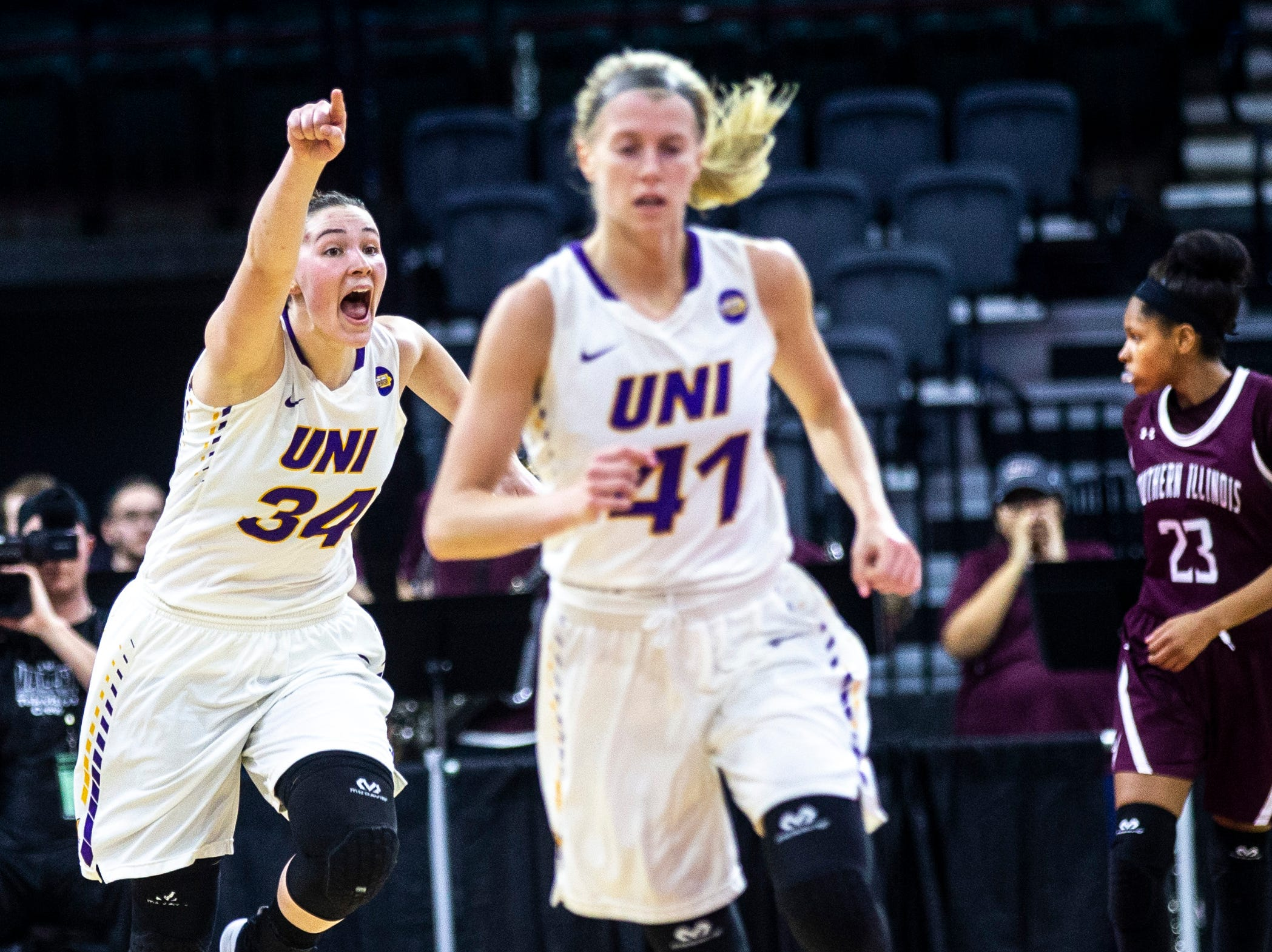 Northern Iowa forward Taylor Hagen (34) calls out to teammates while running back on defense with Northern Iowa guard Abby Gerrits (41) during a NCAA Missouri Valley Conference women's basketball quarterfinal tournament game, Friday, March 15, 2019, at the TaxSlayer Center in Moline, Illinois.