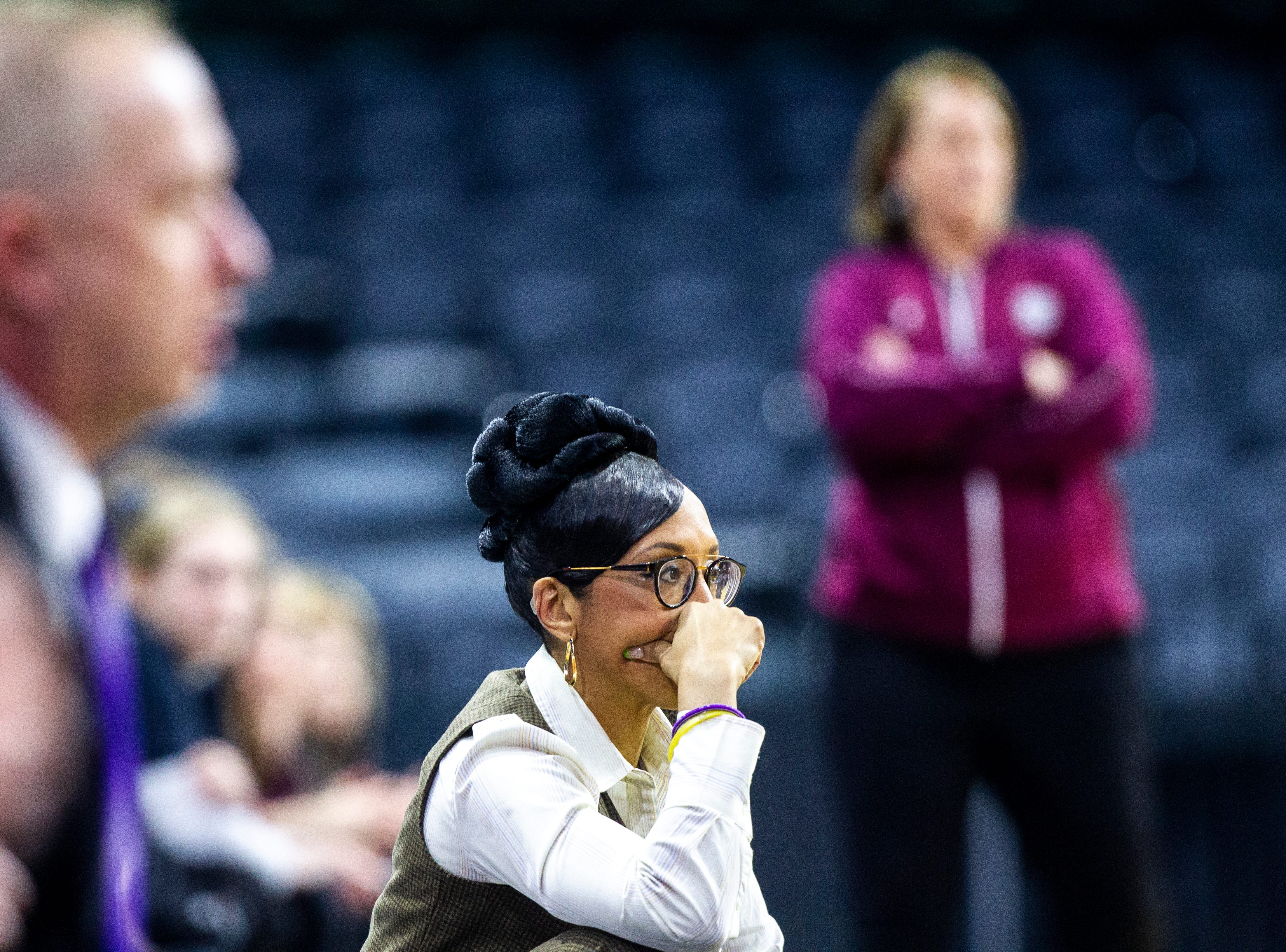 Northern Iowa head coach Tanya Warren, center, looks on during a NCAA Missouri Valley Conference women's basketball quarterfinal tournament game, Friday, March 15, 2019, at the TaxSlayer Center in Moline, Illinois.