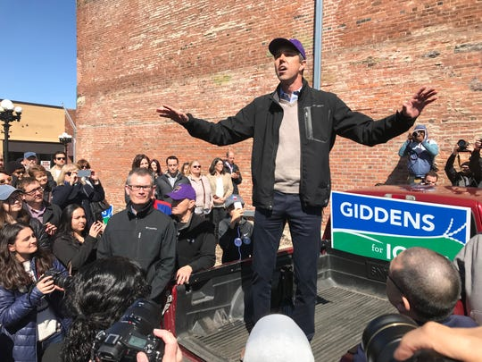 Democratic presidential candidate Beto O'Rourke speaks to a crowd on a downtown Waterloo street corner Saturday. He stopped to campaign for state Senate candidate Eric Giddens.