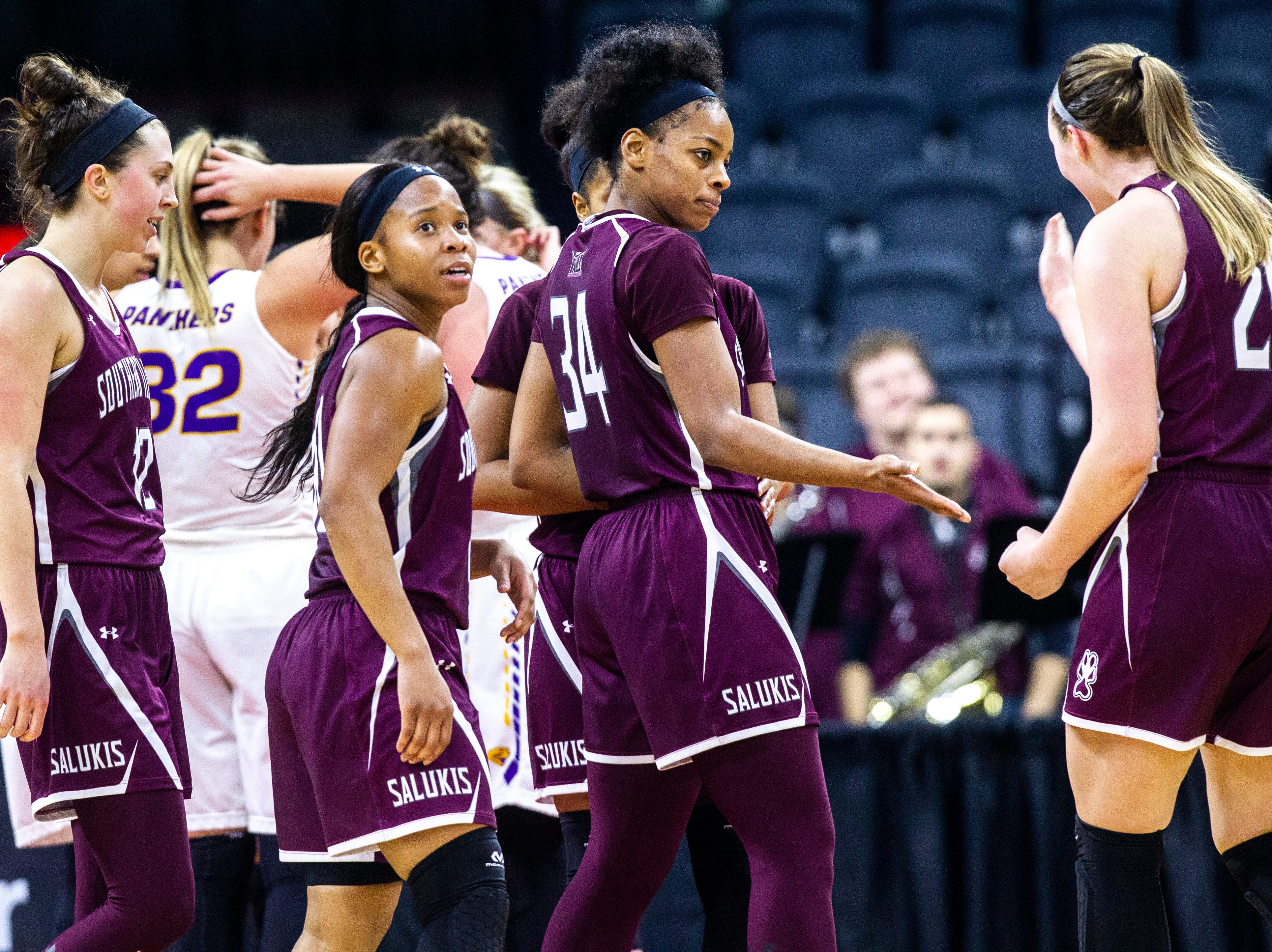 Southern Illinois forward Nicole Martin (34) goes for a high-five from Southern Illinois forward Abby Brockmeyer (25) during a NCAA Missouri Valley Conference women's basketball quarterfinal tournament game, Friday, March 15, 2019, at the TaxSlayer Center in Moline, Illinois.