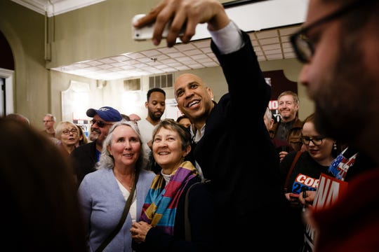 New Jersey Senator and 2020 Democratic presidential candidate Cory Booker takes a selfie during a campaign event at Hotel Ottumwa on Saturday, March 16, 2019 in Ottumwa.