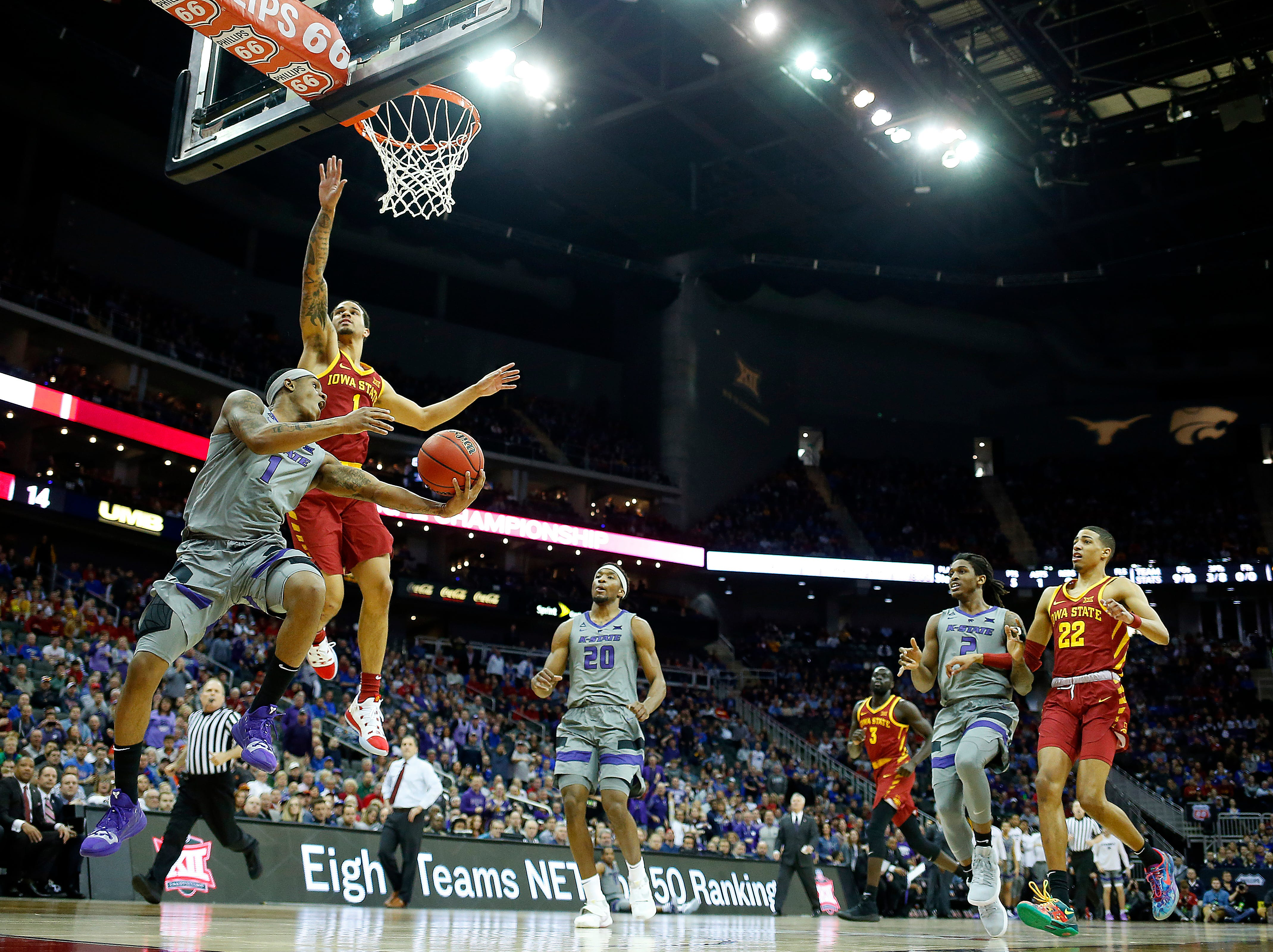 KANSAS CITY, MISSOURI - MARCH 15:  Shaun Neal-Williams #1 of the Kansas State Wildcats drives toward the basket as Nick Weiler-Babb #1 of the Iowa State Cyclones defends during the semifinal game of the Big 12 Basketball Tournament at Sprint Center on March 15, 2019 in Kansas City, Missouri. (Photo by Jamie Squire/Getty Images)