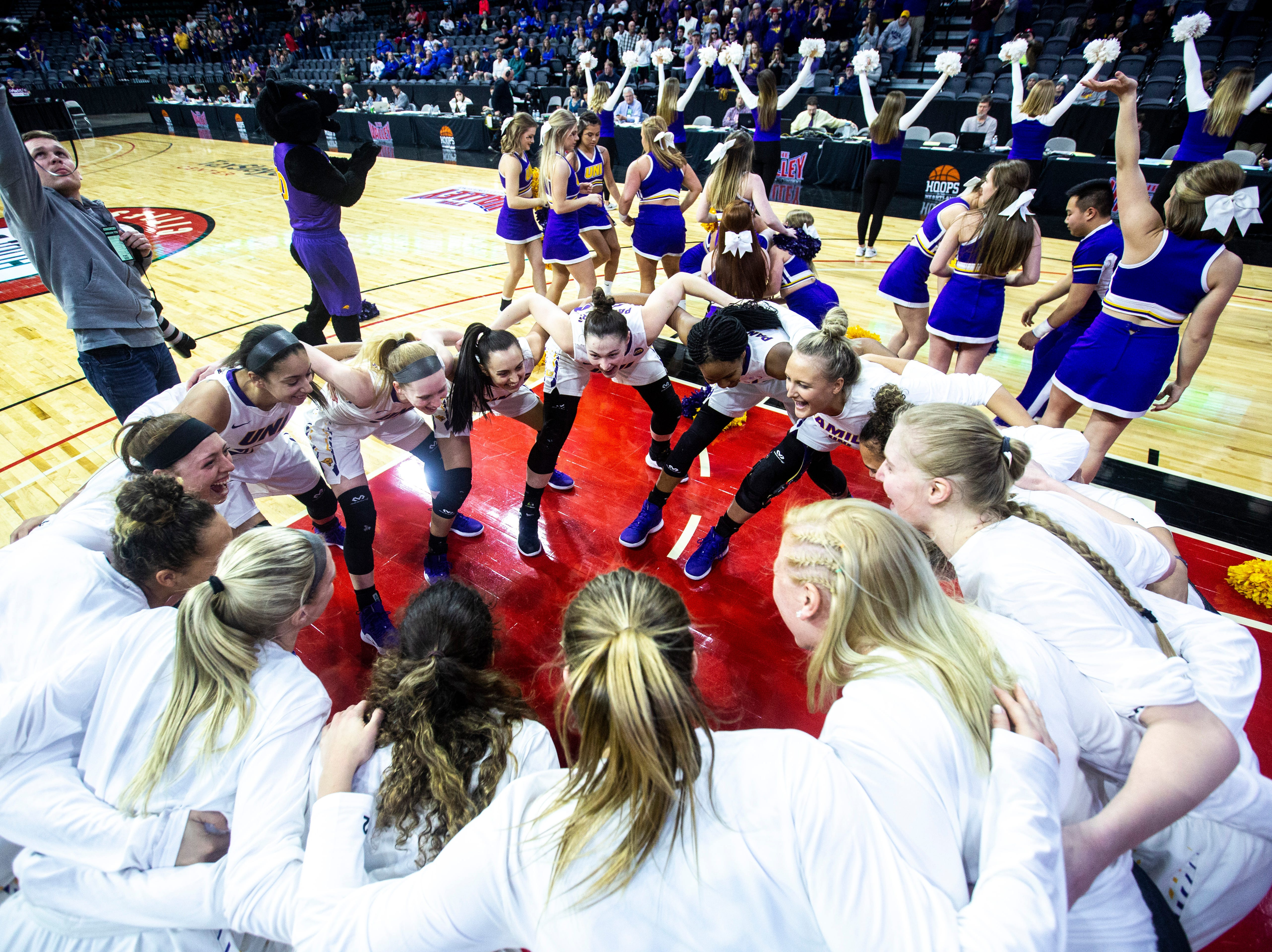 Northern Iowa Panthers following introductions during a NCAA Missouri Valley Conference women's basketball quarterfinal tournament game, Friday, March 15, 2019, at the TaxSlayer Center in Moline, Illinois.