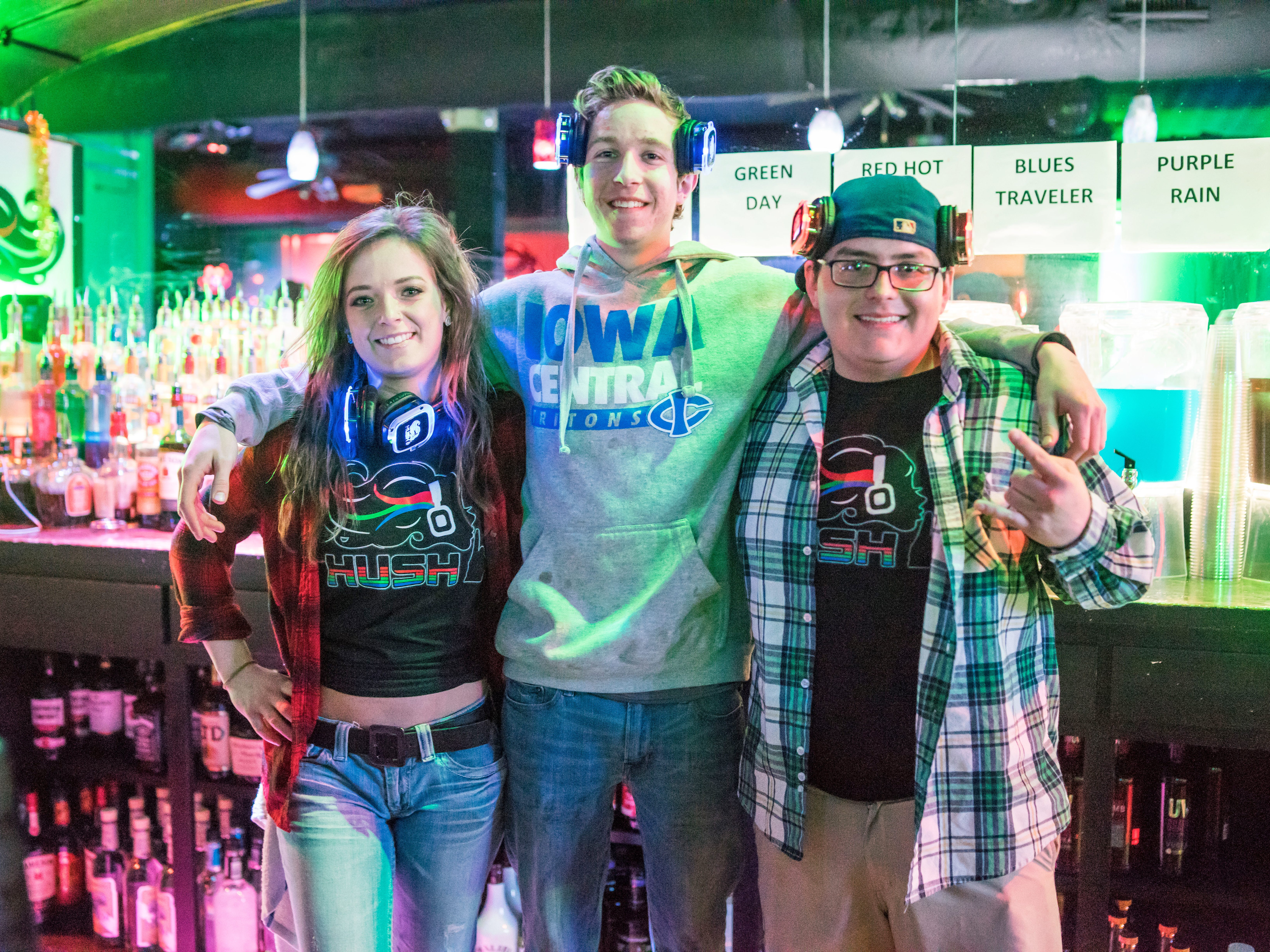 Inos Gomez, 24, Mitchell Wagler, 21, and Brooke Hoffman, 24, all of Des Moines, enjoying their time, Friday, March 15th, at Hush.