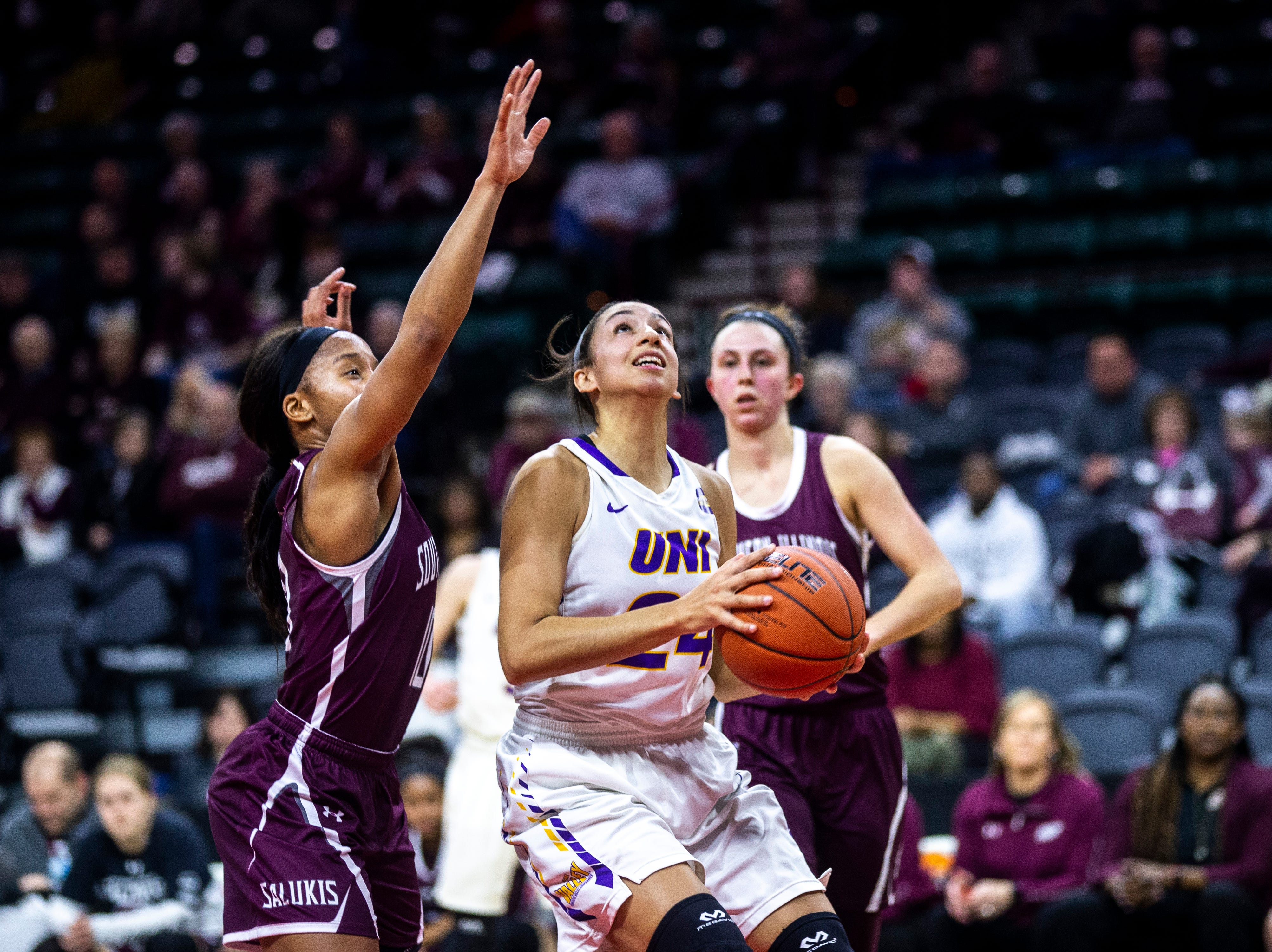 Northern Iowa guard Mikaela Morgan (24) drives to the basket against Southern Illinois during a NCAA Missouri Valley Conference women's basketball quarterfinal tournament game, Friday, March 15, 2019, at the TaxSlayer Center in Moline, Illinois.