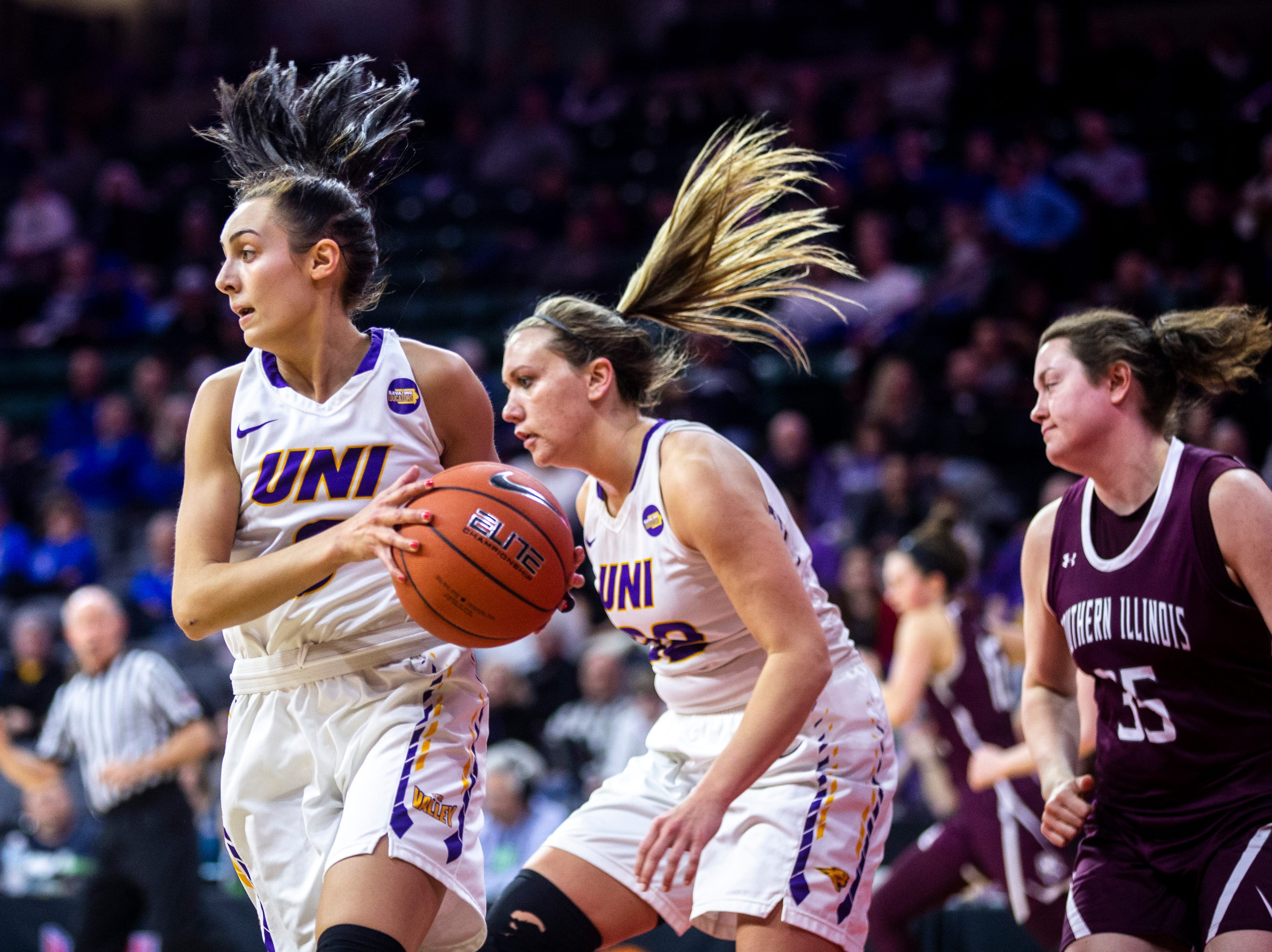 Northern Iowa guard Karli Rucker (3) pulls down a rebound during a NCAA Missouri Valley Conference women's basketball quarterfinal tournament game, Friday, March 15, 2019, at the TaxSlayer Center in Moline, Illinois.
