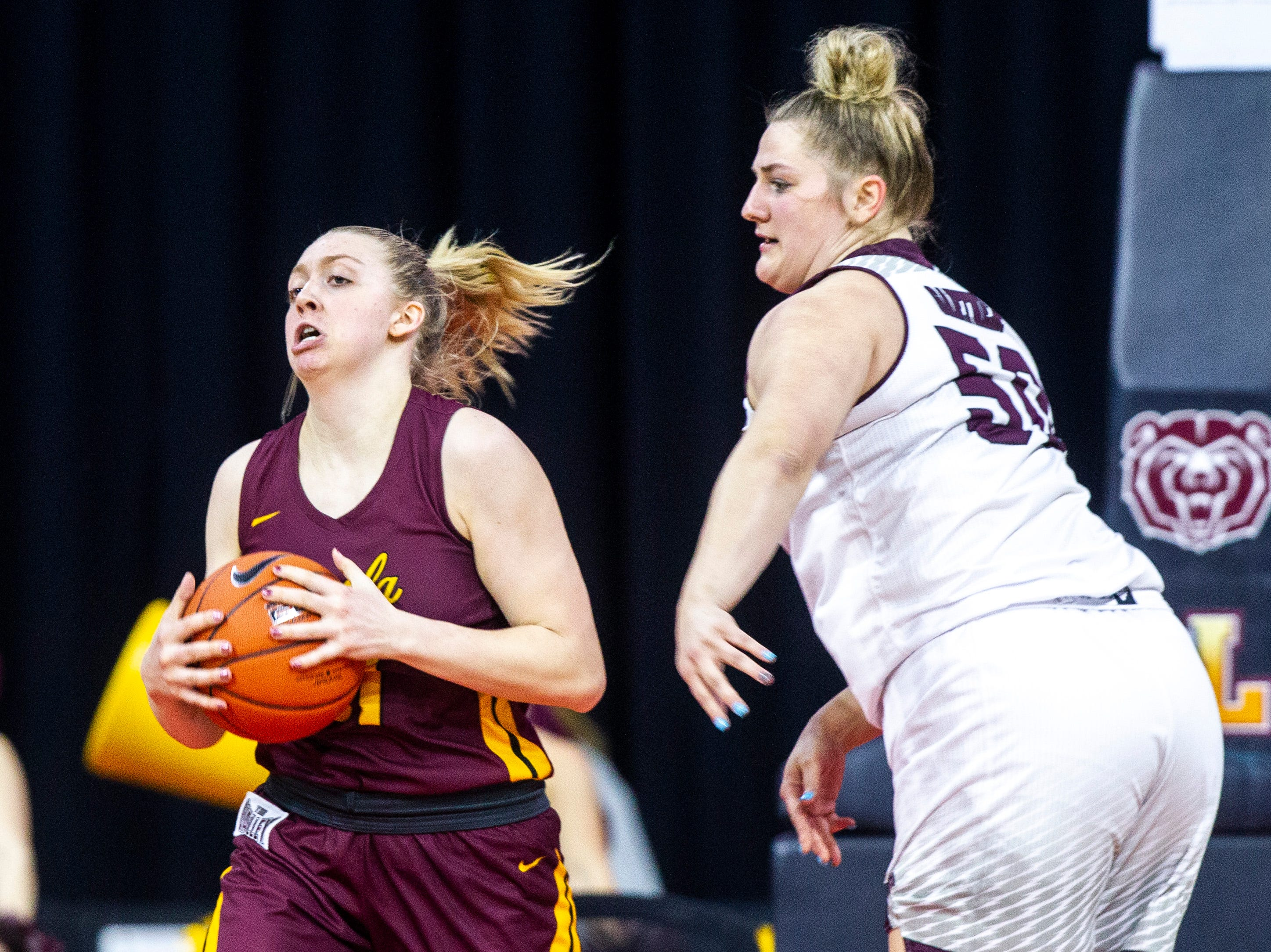 Loyola (Chicago) forward Allison Day (21) grabs a rebound against Missouri State center Emily Gartner (50) during a NCAA Missouri Valley Conference women's basketball quarterfinal tournament game, Friday, March 15, 2019, at the TaxSlayer Center in Moline, Illinois.