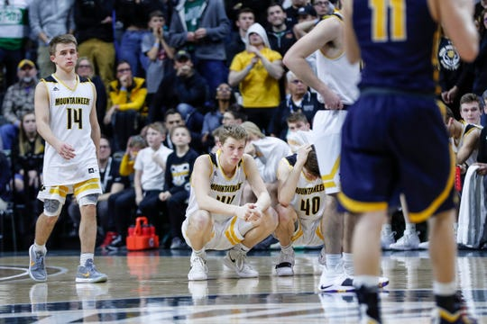 Iron Mountain's Marcus Johnson (14), Charlie Gerhard (44), and Foster Wonders (00) reacts to a call in the last seconds of the second half of MHSAA Division 3 final against Pewamo-Westphalia at the Breslin Center in East Lansing, Saturday, March 16, 2019.