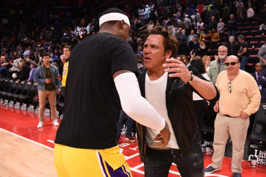 Detroit Pistons owner Tom Gores and Los Angeles Lakers guard Kentavious Caldwell-Pope hug after the game at Little Caesars Arena, Friday, March 15, 2019, in Detroit.