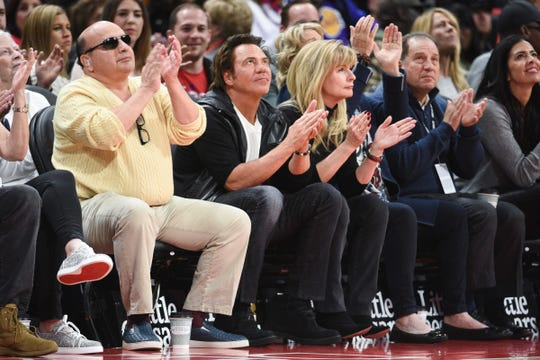 Detroit Pistons owner Tom Gores, center, and vice chairman Arn Tellem, right, during the game against the Los Angeles Lakers at Little Caesars Arena, Friday, March 15, 2019, in Detroit.