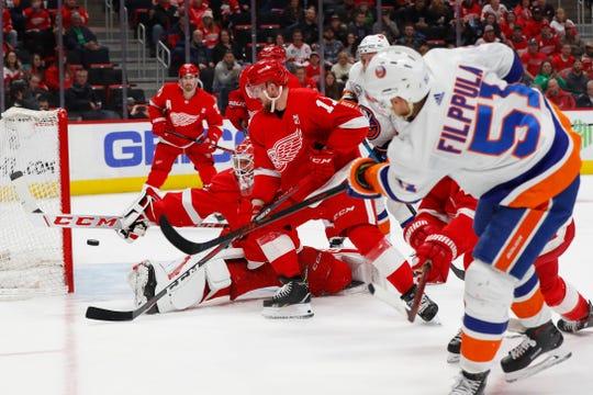 Detroit Red Wings goaltender Jonathan Bernier (45) stops a New York Islanders center Valtteri Filppula (51) shot in the third period of an NHL hockey game, Saturday, March 16, 2019, in Detroit. (AP Photo/Paul Sancya)