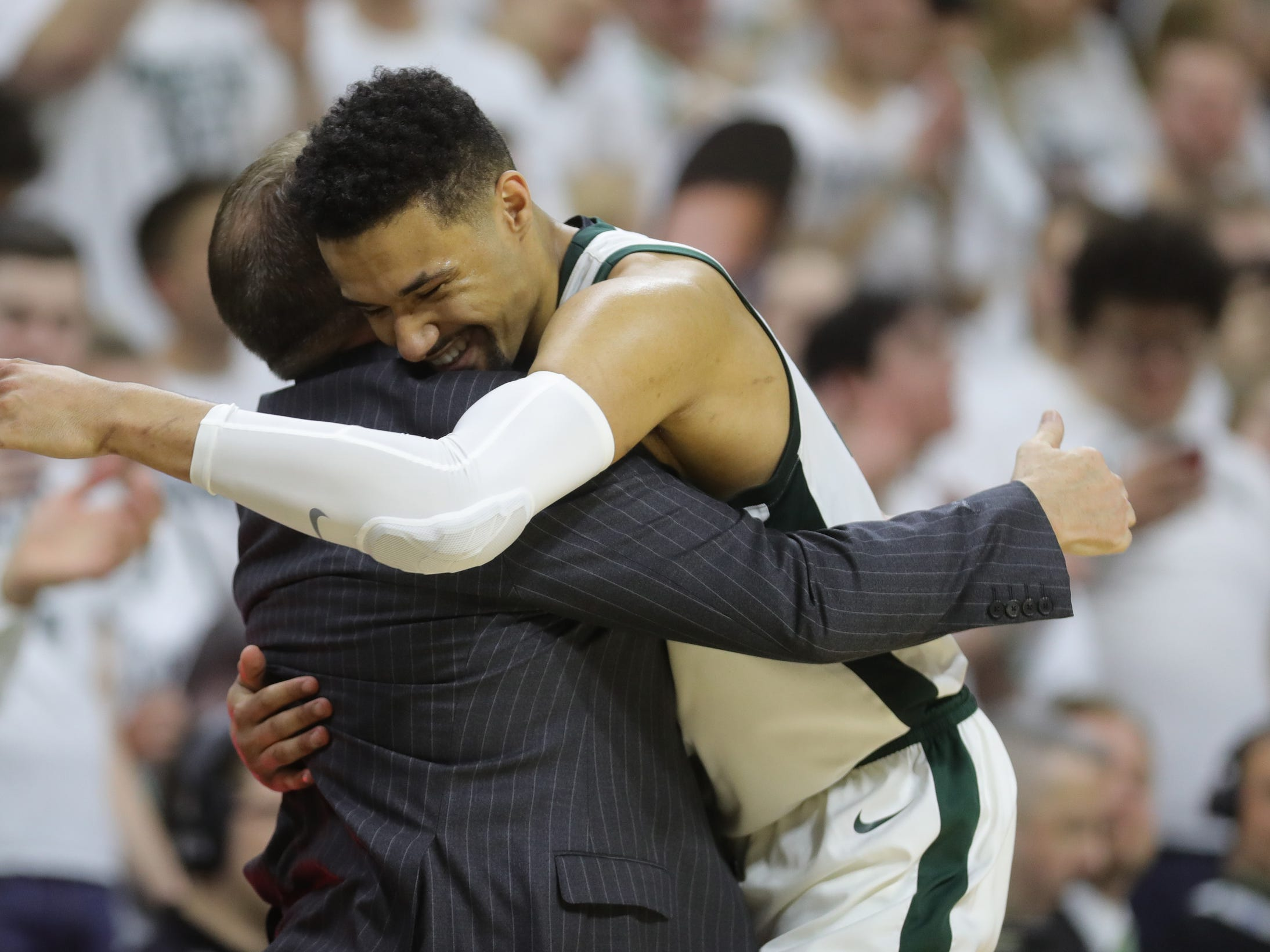 Michigan State coach Tom Izzo hugs forward Kenny Goins, after the 75-63 win against Michigan, March 9, 2019 at the Breslin Center in East Lansing.