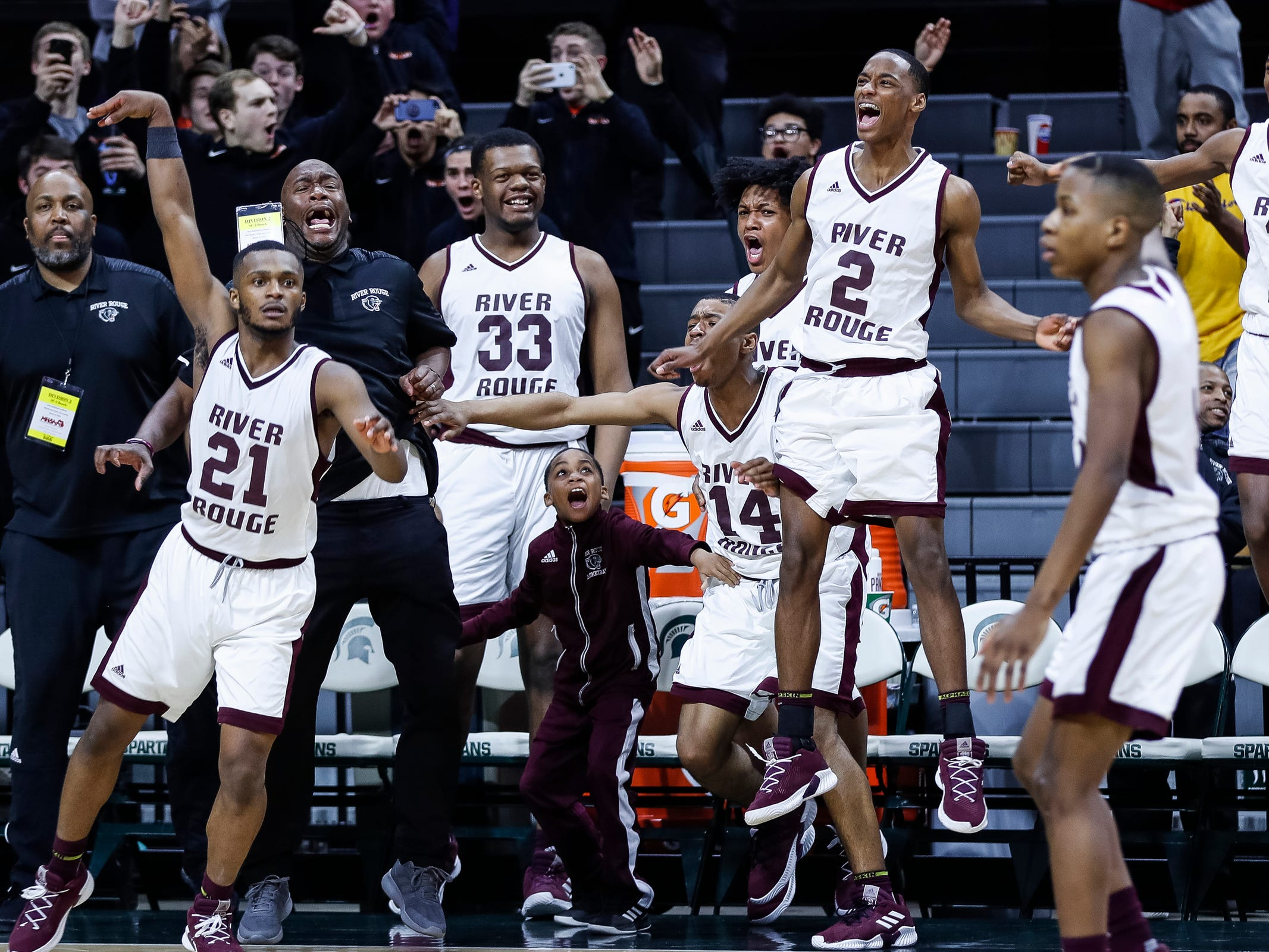 River Rouge bench celebrate a play against Harper Woods Chandler Park during the second half of MHSAA Division 2 semifinal at the Breslin Center in East Lansing, Friday, March 15, 2019.
