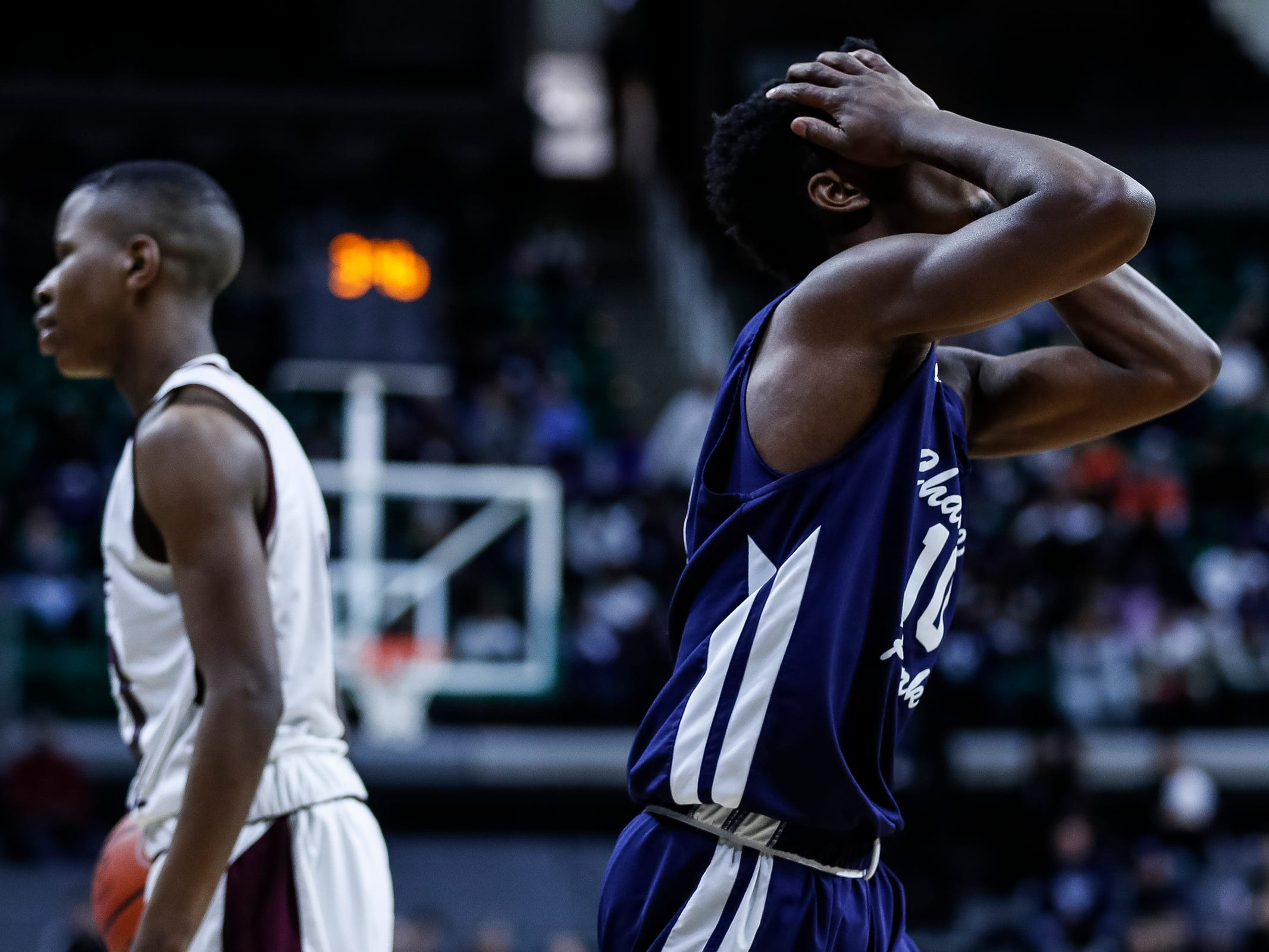 Harper Woods Chandler Park's Josh Diggs (10) reacts to a personal foul during the second half of MHSAA Division 2 semifinal against River Rouge at the Breslin Center in East Lansing, Friday, March 15, 2019.