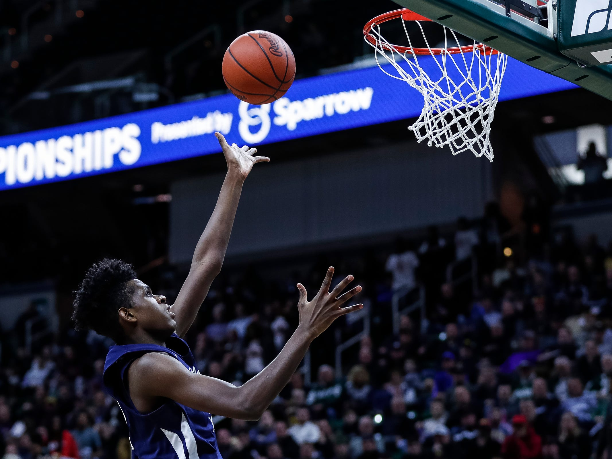 Harper Woods Chandler Park's Emmanuel Ndambi (12) makes a layup against River Rouge during the first half of MHSAA Division 2 semifinal at the Breslin Center in East Lansing, Friday, March 15, 2019.