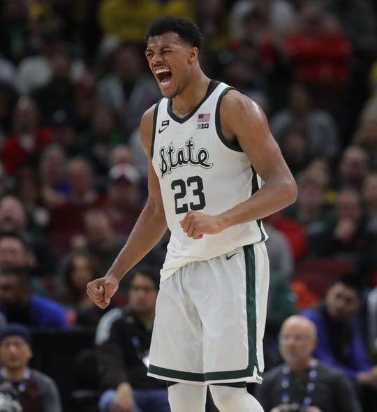 Xavier Tillman reacts after scoring against Wisconsin in the Big Ten tournament semifinal Saturday in Chicago.